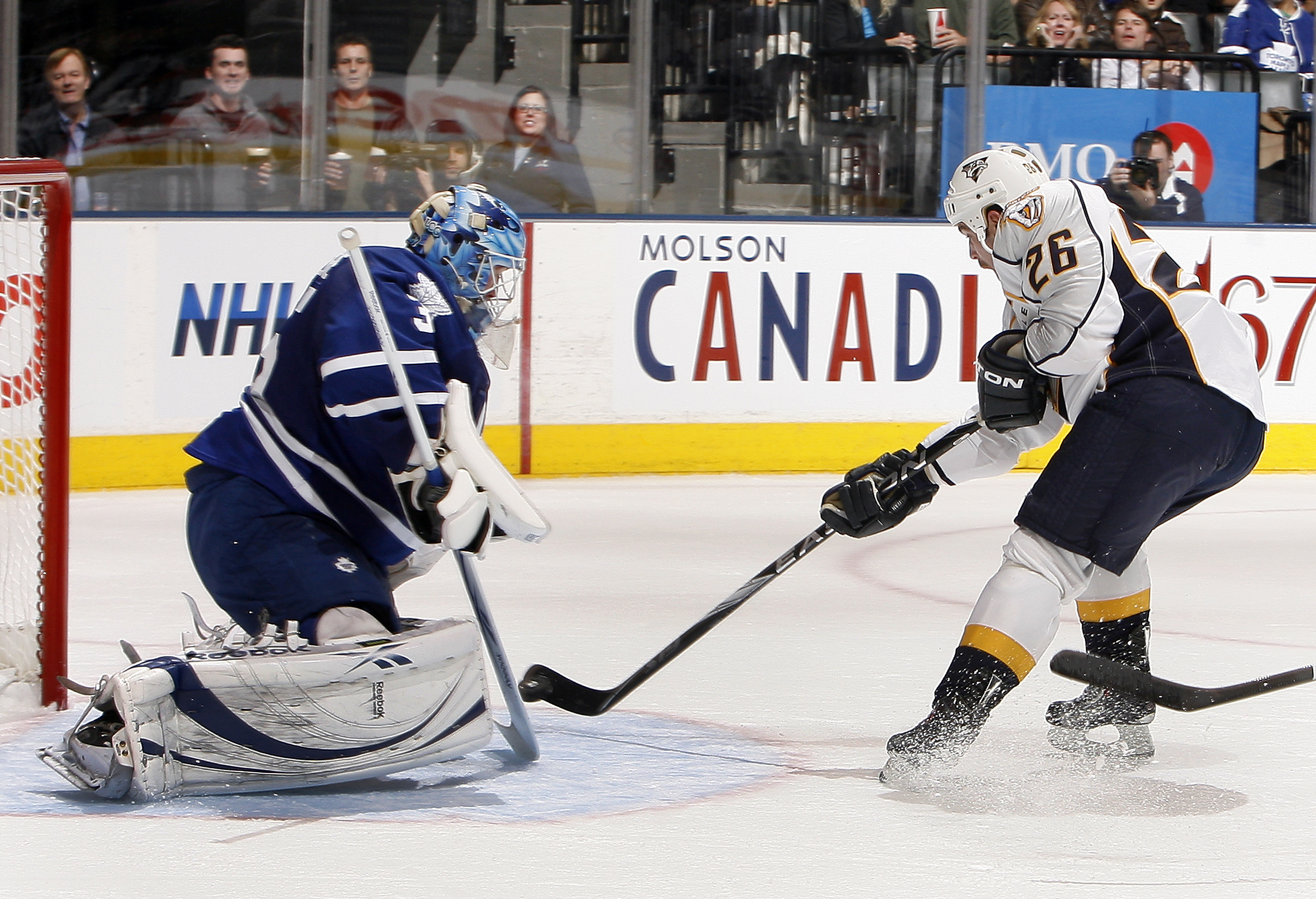 TORONTO - NOVEMBER 16: Jean-Sebastien Giguere #35 of the Toronto Maple Leafs makes a save on Steve Sullivan #26 of the Nashville Predators during game action at the Air Canada Centre November 16, 2010 in Toronto, Ontario, Canada. (Photo by Abelimages/Gett