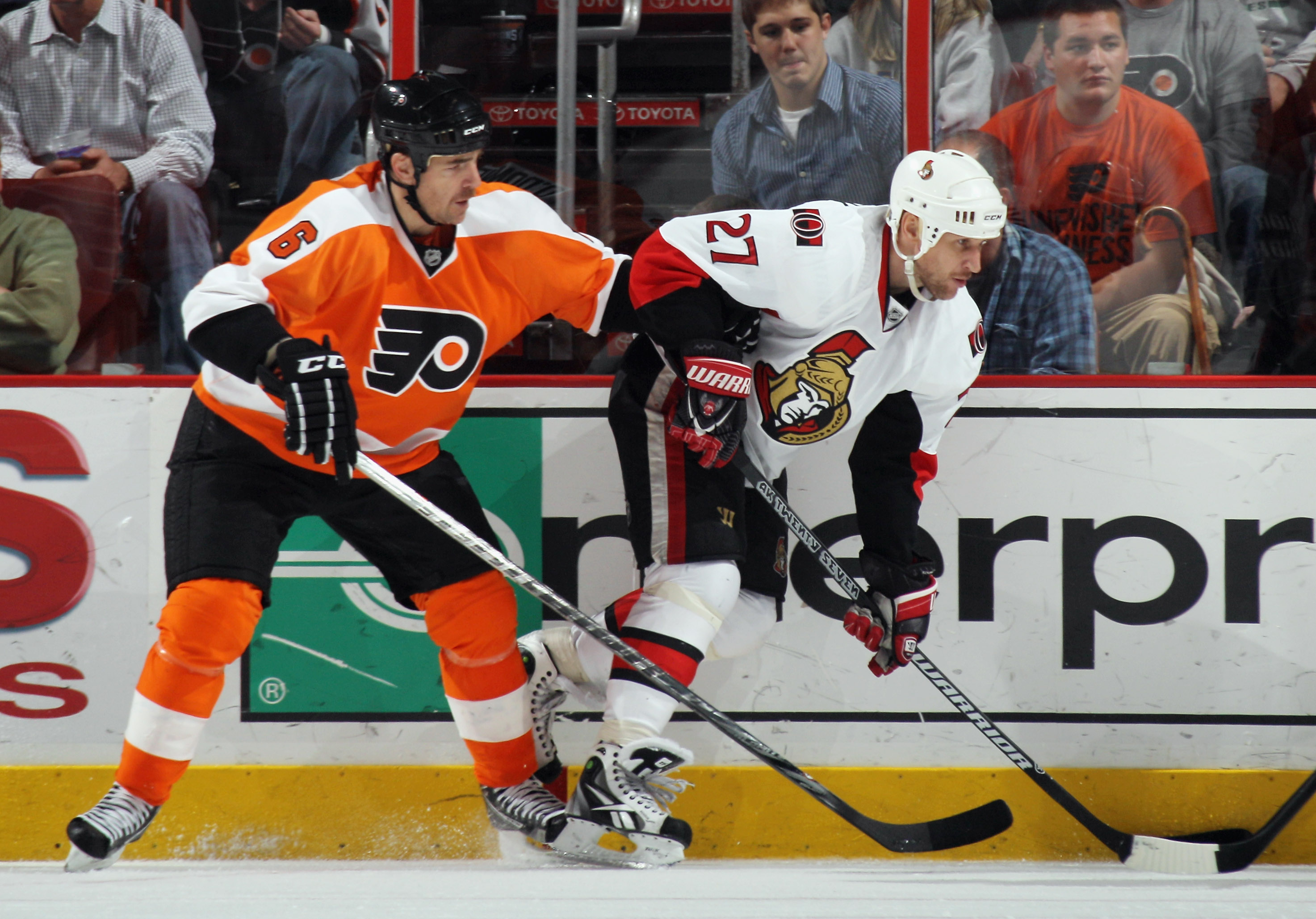 PHILADELPHIA - NOVEMBER 15: Alex Kovalev #27 of the Ottawa Senators is checked by Sean O'Donnell #6 of the Philadelphia Flyers at the Wells Fargo Center on November 15, 2010 in Philadelphia, Pennsylvania. The Flyers defeated the Senators 5-1. (Photo by Br