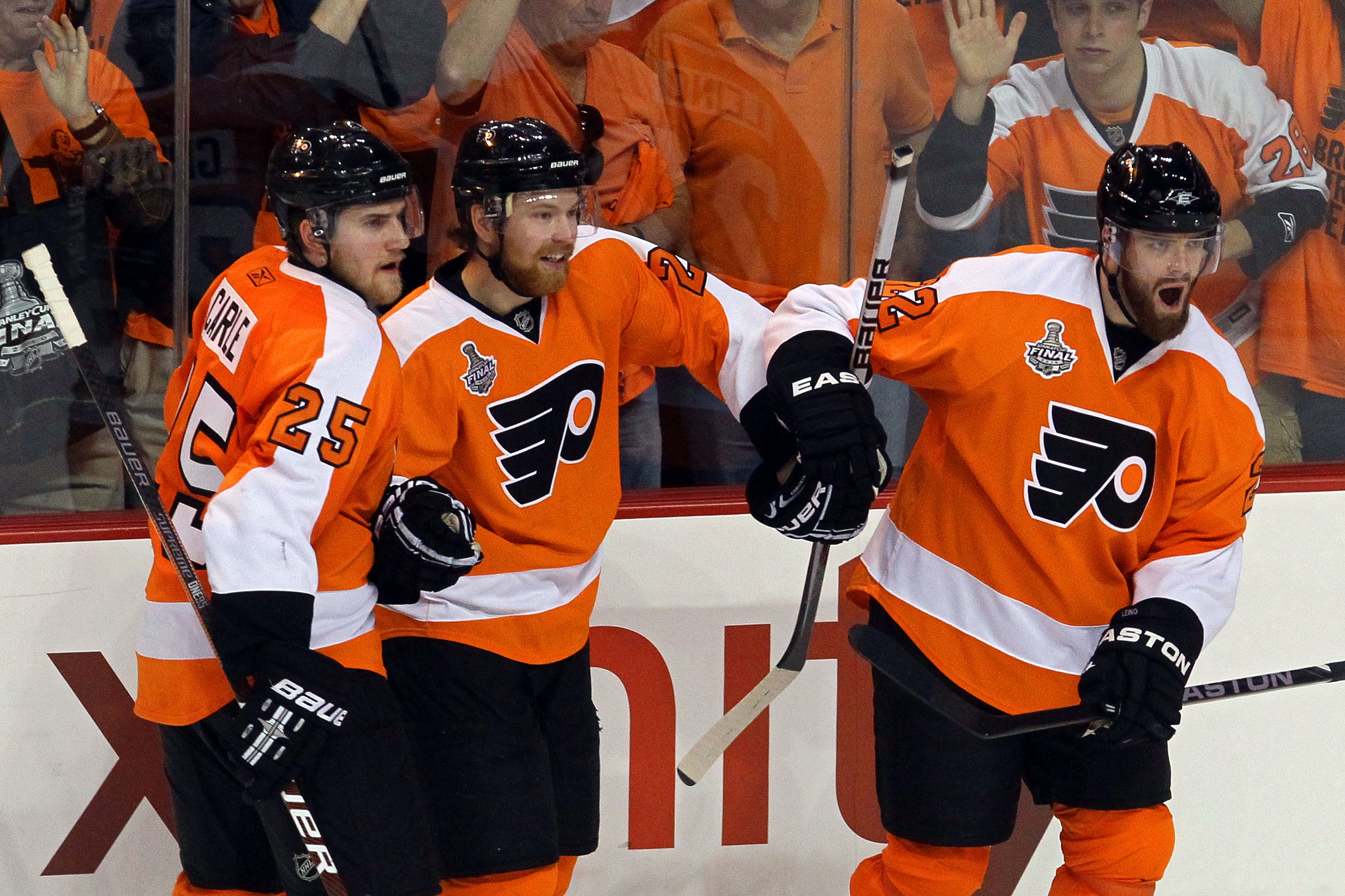 PHILADELPHIA - JUNE 02:  Ville Leino #22 of the Philadelphia Flyers celebrates with teammates Matt Carle #25 and Claude Giroux #28 after scoring a goal in the third period against the Chicago Blackhawks in Game Three of the 2010 NHL Stanley Cup Final at W