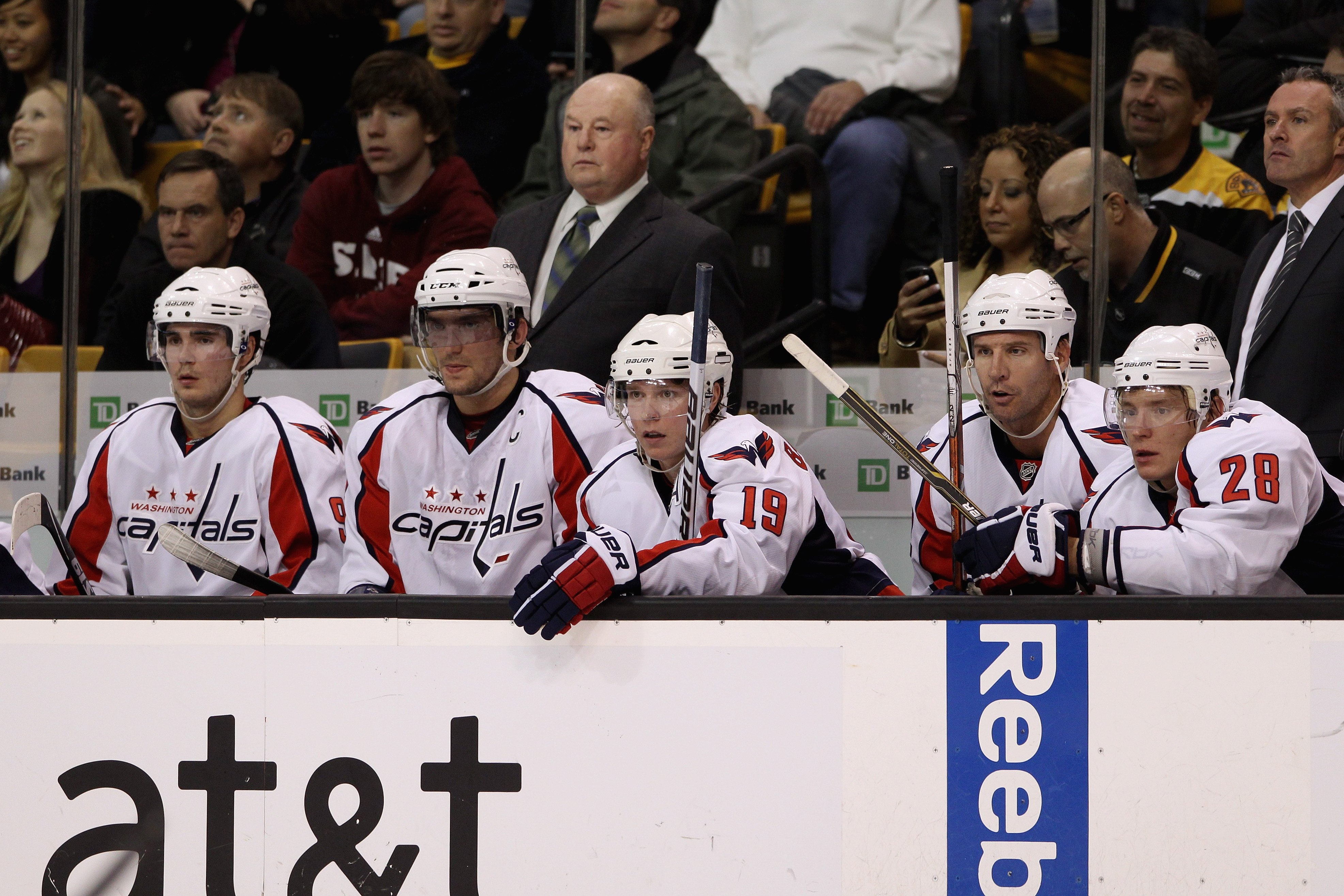 BOSTON - OCTOBER 21:  Head coach Bruce Boudreau of the Washington Capitals and (l-r) Marcus Johansson #90, Alex Ovechkin #8, Nicklas Backstrom #19, Mike Knuble #22, Alexander Semin #28 and assistant coach Dean Evason look on from the bench against the Bos
