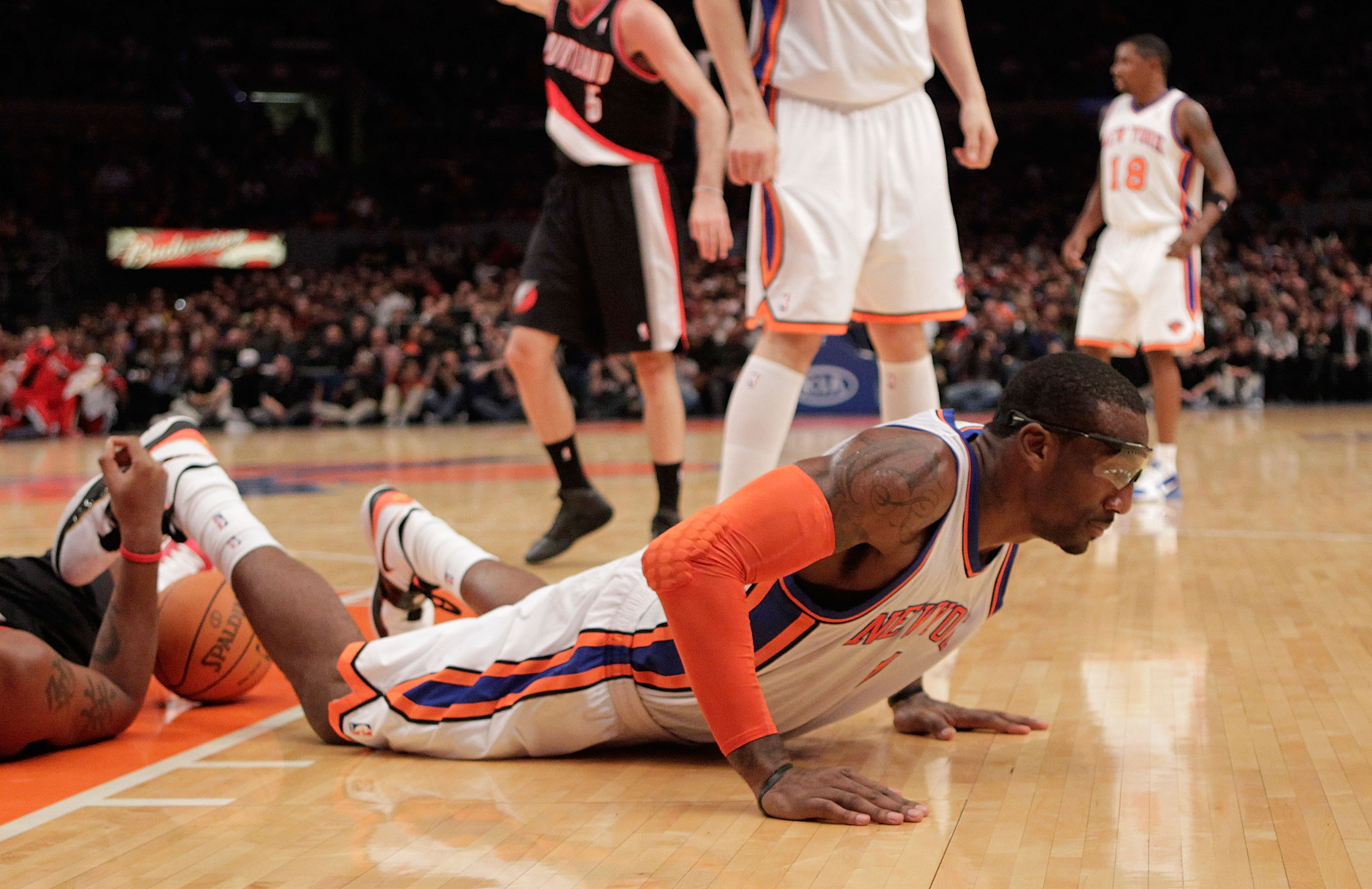 NEW YORK - OCTOBER 30:  Amar'e Stoudemire #1 of the New York Knicks on the ground after being called for a charging foul against the Portland Trail Blazers at Madison Square Garden on October 30, 2010 in New York City. NOTE TO USER: User expressly acknowl