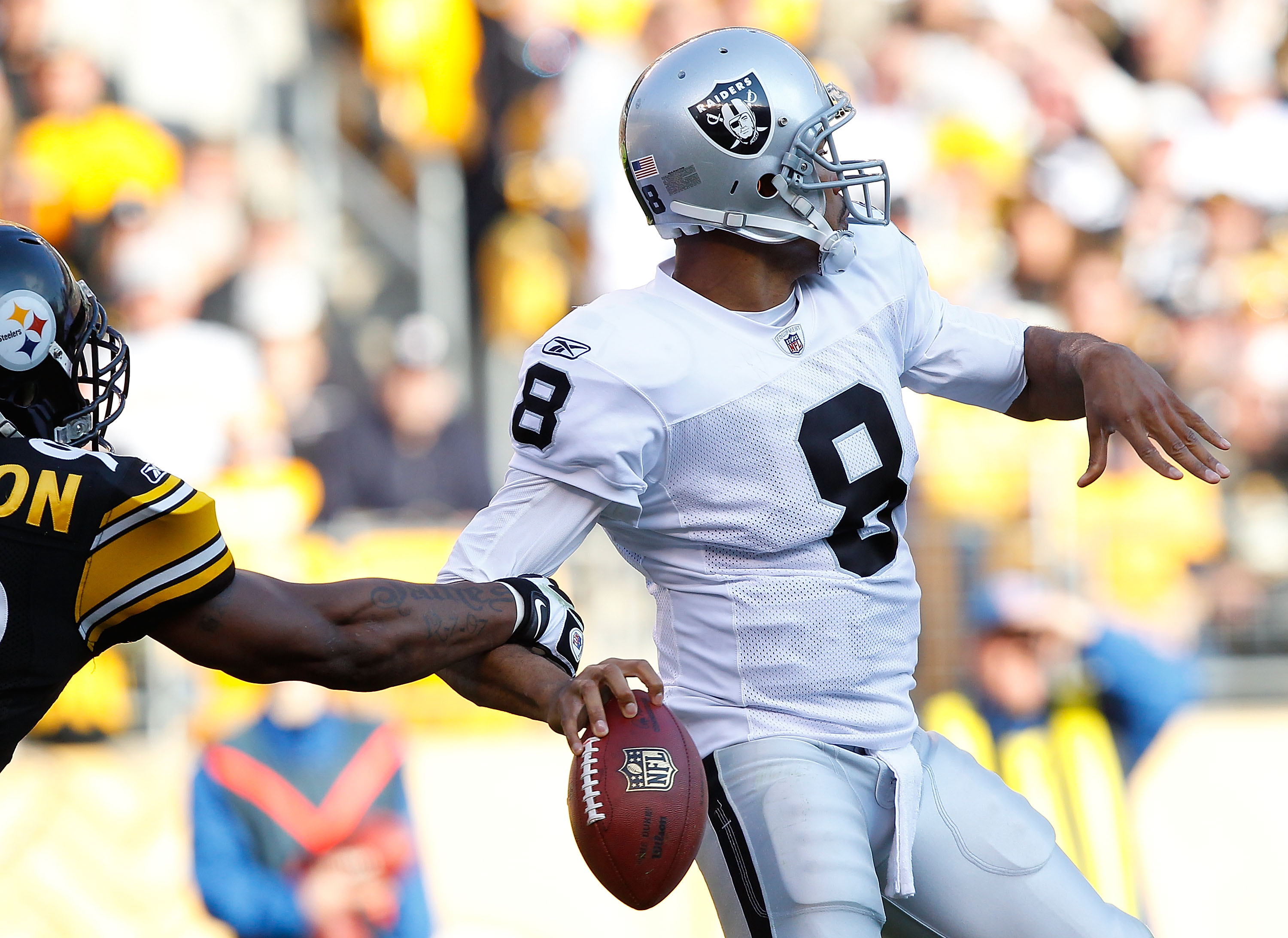 PITTSBURGH - NOVEMBER 21:  Jason Campbell #8 of the Oakland Raiders has the ball stripped from his hand by James Harrison #92 of the Pittsburgh Steelers during the game on November 21, 2010 at Heinz Field in Pittsburgh, Pennsylvania.  (Photo by Jared Wick