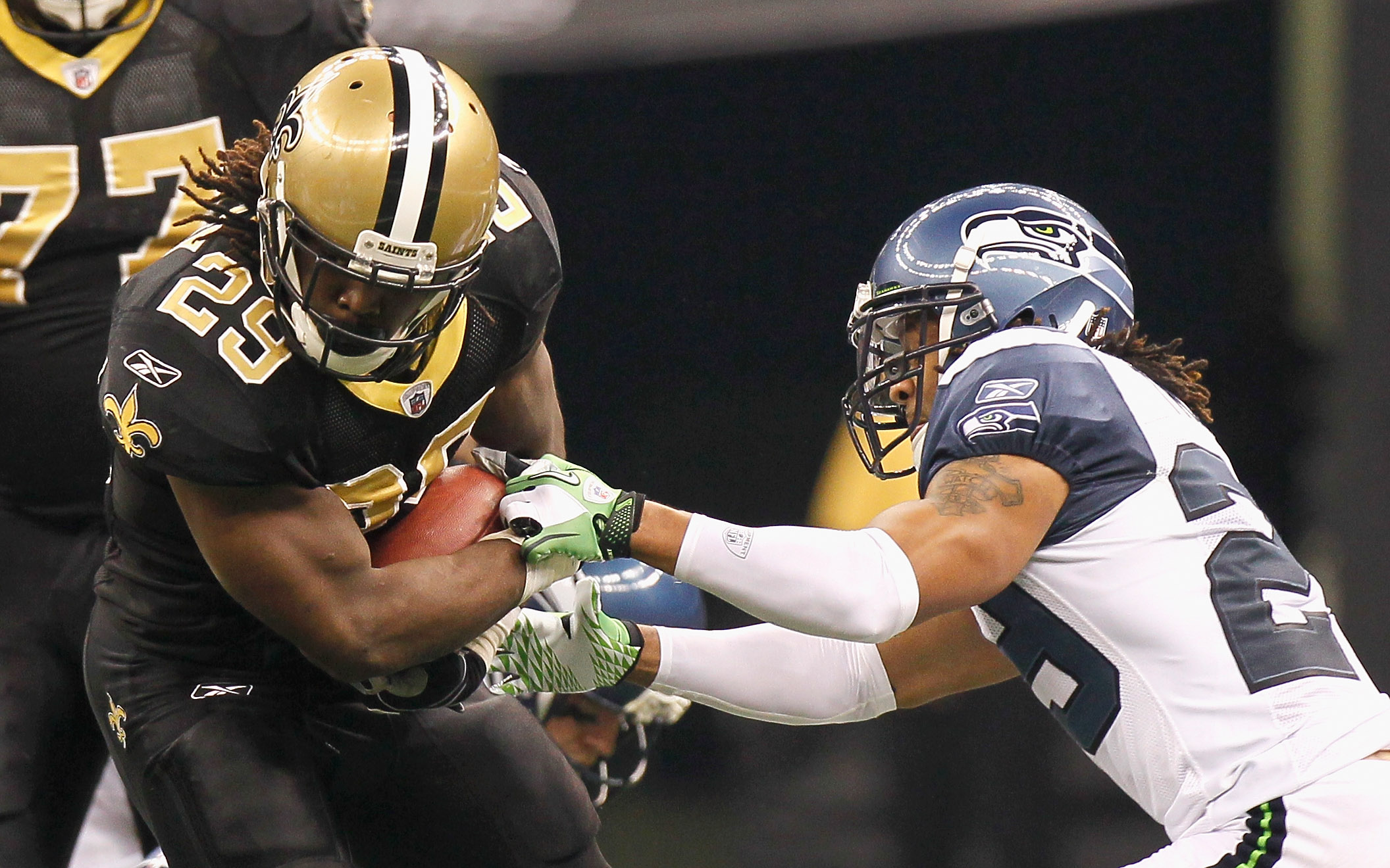 NEW ORLEANS - NOVEMBER 21:  Earl Thomas #29 of the Seattle Seahawks tries to strip the ball from Chris Ivory #29 of the New Orleans Saints at Louisiana Superdome on November 21, 2010 in New Orleans, Louisiana.  (Photo by Kevin C. Cox/Getty Images)