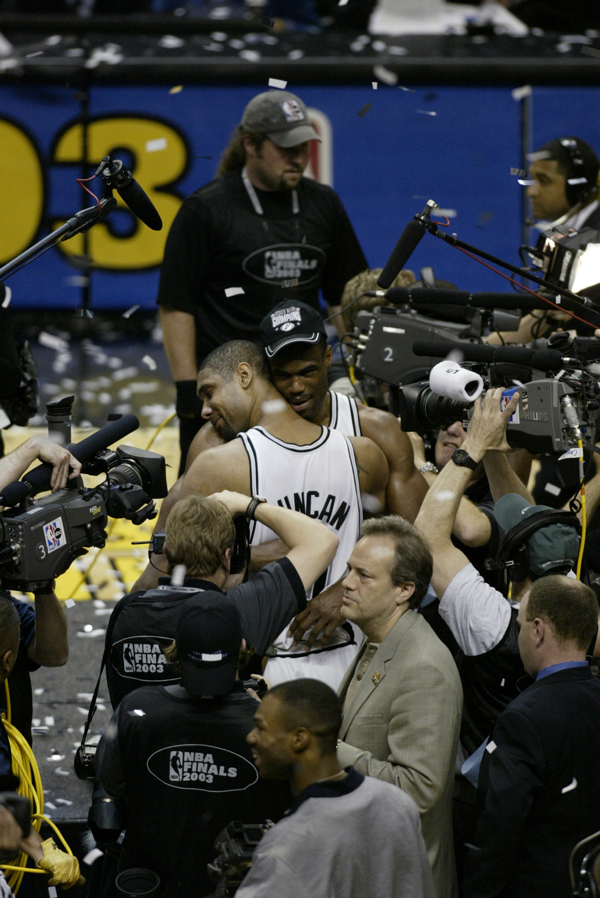 SAN ANTONIO - JUNE 15:  David Robinson #50 and Tim Duncan #21 of the San Antonio Spurs celebrate the NBA Championship after defeating the New Jersey Nets in game six of the 2003 NBA Finals at the SBC Center on June 15, 2003 in San Antonio, Texas.  The Spu