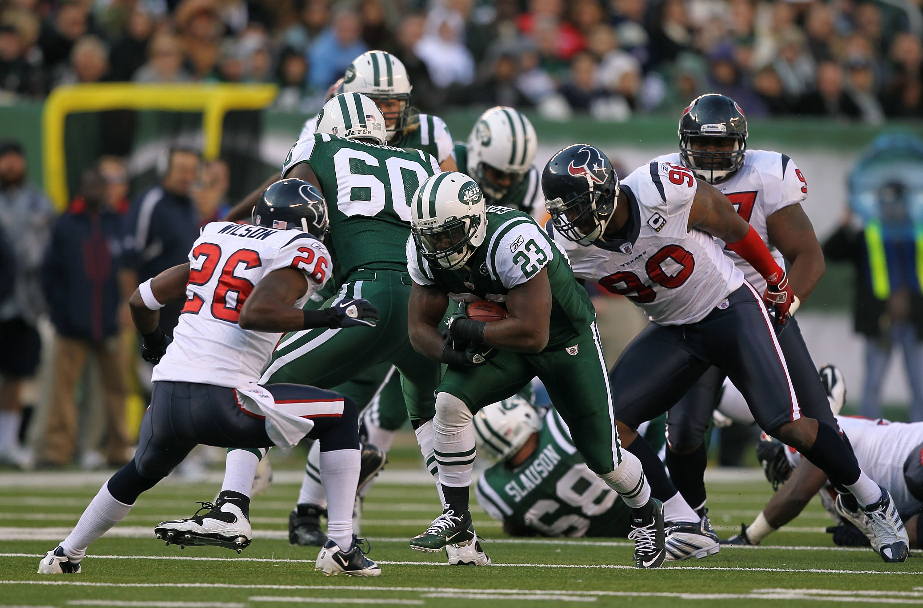 EAST RUTHERFORD, NJ - NOVEMBER 21:  Shonn Greene #23 of the New York Jets runs against Eugene Wilson #26 of the Houston Texans on November 21, 2010 at the New Meadowlands Stadium in East Rutherford, New Jersey.  (Photo by Al Bello/Getty Images)