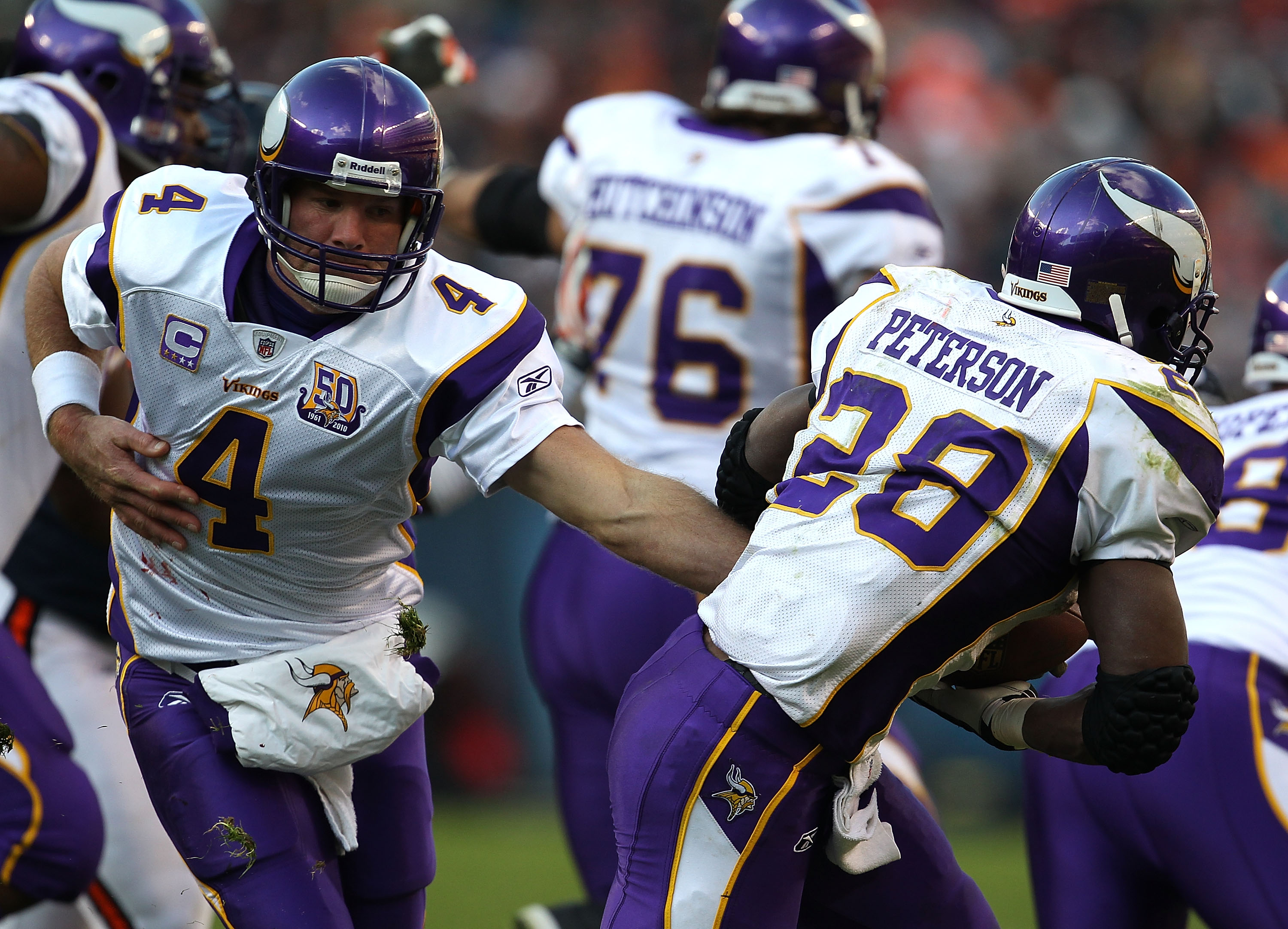 CHICAGO - NOVEMBER 14: Brett Favre #4 of the Minnesota Vikings hands off to Adrian Peterson #28 against the Chicago Bears at Soldier Field on November 14, 2010 in Chicago, Illinois. The Bears defeated the Vikings 27-13. (Photo by Jonathan Daniel/Getty Ima