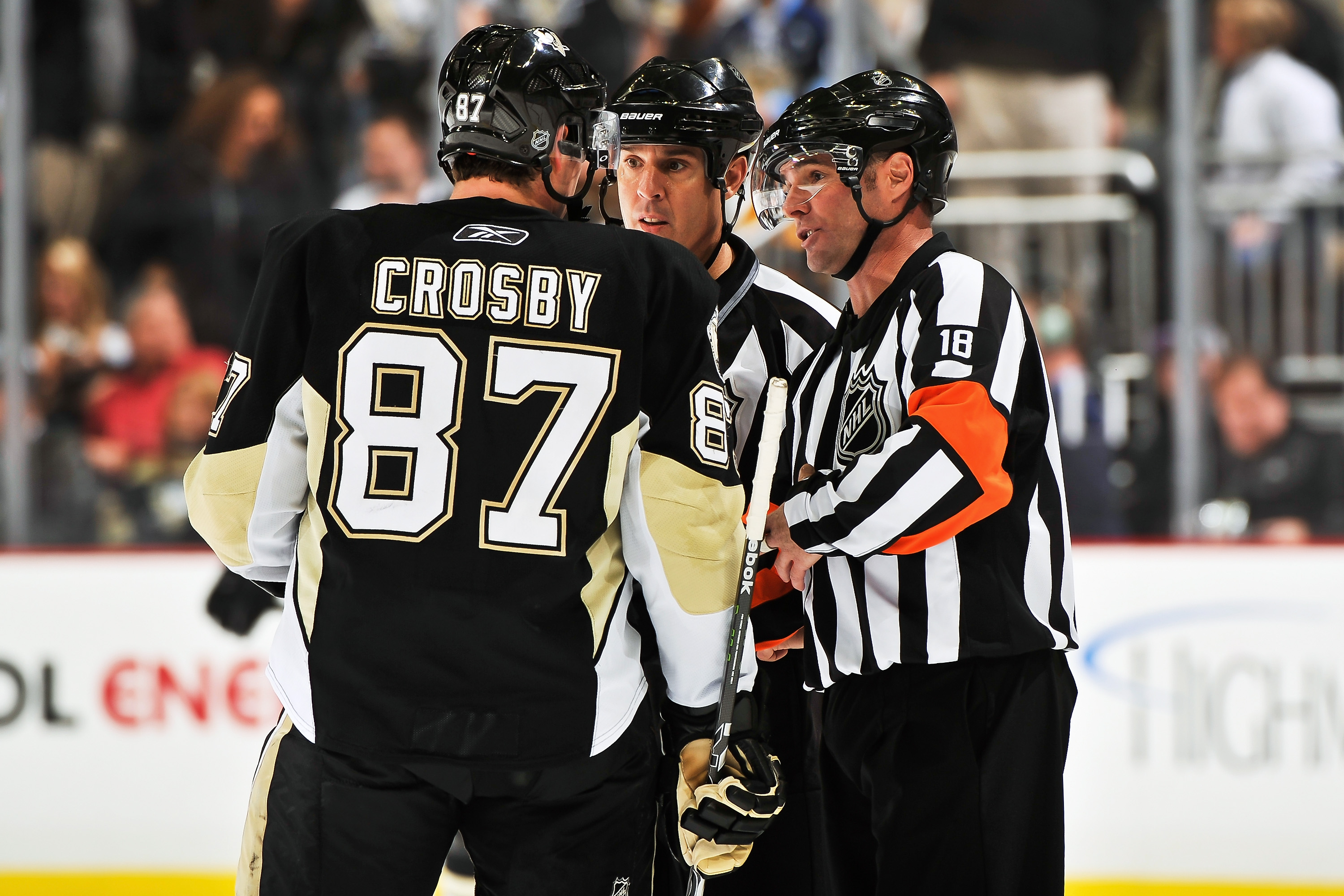 PITTSBURGH - NOVEMBER 19:  Sidney Crosby #87 of the Pittsburgh Penguins talks with officials Tony Sericolo #84 and Greg Kimmerly #18 during a game against the Carolina Hurricanes on November 19, 2010 at Consol Energy Center in Pittsburgh, Pennsylvania.  (