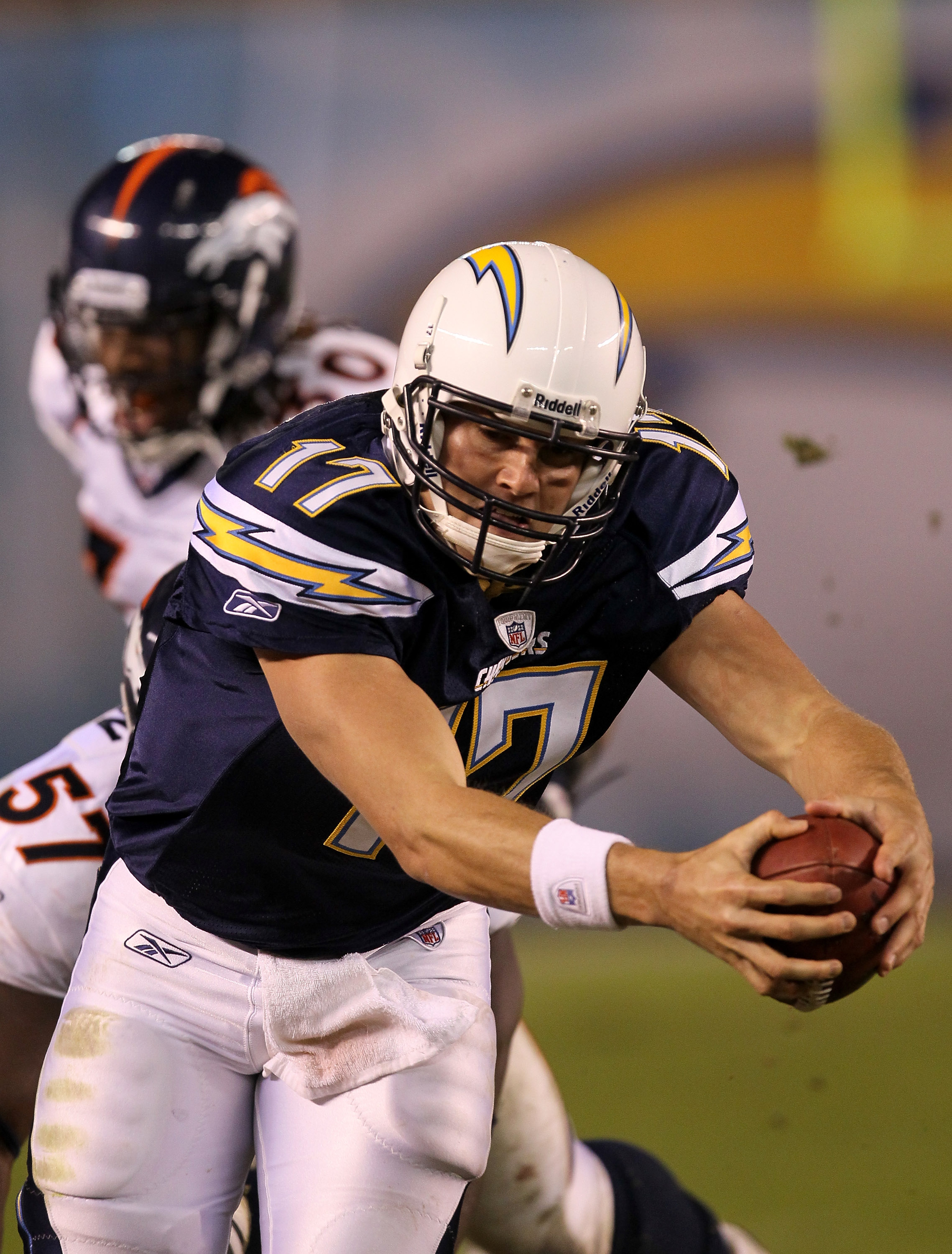 SAN DIEGO - NOVEMBER 22:  Quarterback Philip Rivers #17 of the San Diego Chargers reaches the ball to the sideline down marker as he scrambles for a first down against the Denver Broncos at Qualcomm Stadium on November 22, 2010 in San Diego, California. T