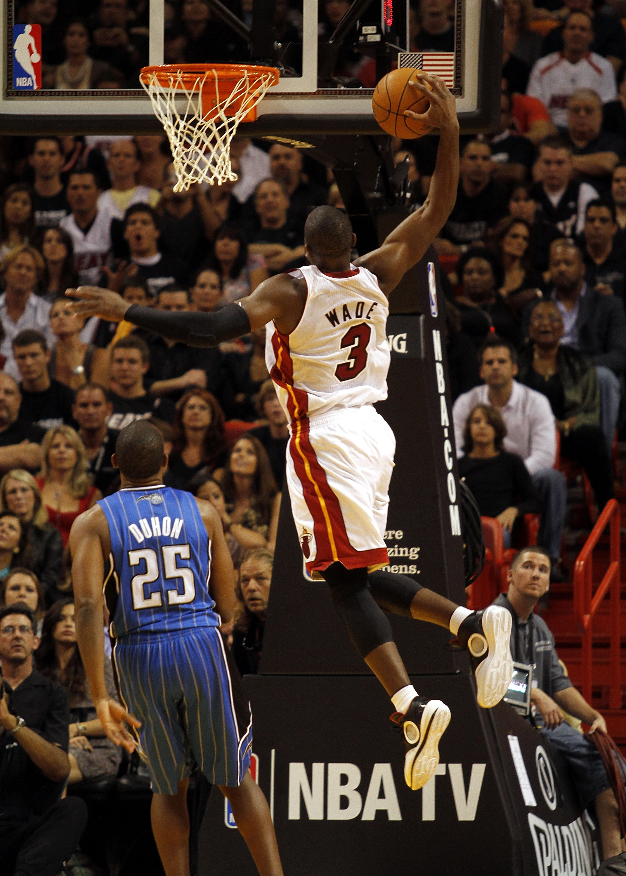 MIAMI - OCTOBER 29:  Guard Dwyane Wade #3 of  the Miami Heat dunks  against the Orlando Magic at American Airlines Arena on October 29, 2010 in Miami, Florida.  NOTE TO USER: User expressly acknowledges and agrees that, by downloading and or using this ph