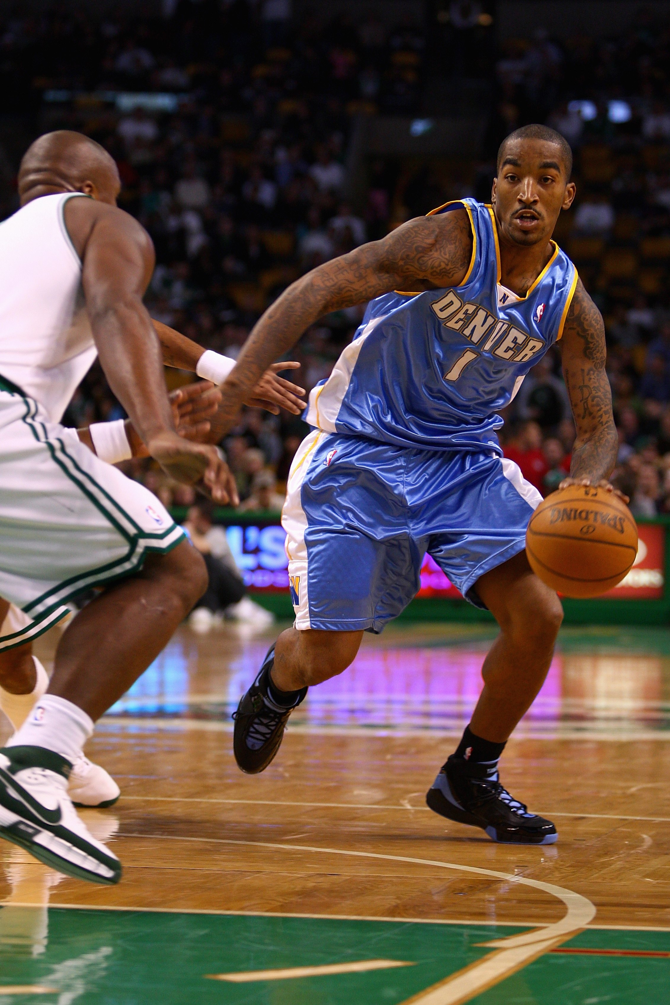 BOSTON - NOVEMBER 7: J.R. Smith #1 of the Denver Nuggets goes up against Glen Davis #11 of the Boston Celtics during the game on November 7, 2007 at the TD Banknorth Garden in Boston, Massachusetts.  The Celtics won 119-93.  NOTE TO USER: User expressly a