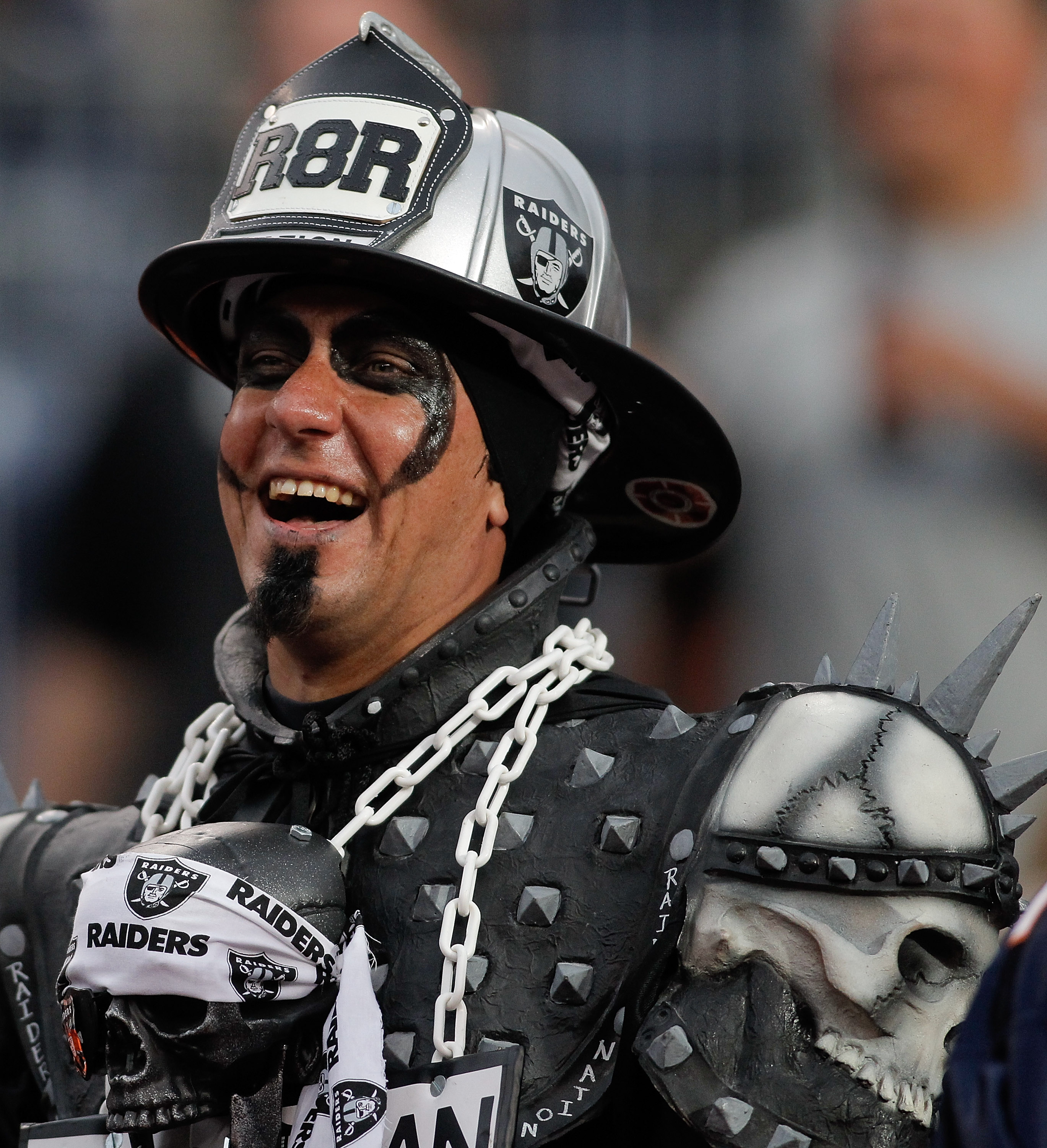 DENVER - OCTOBER 24:  An Oakland Raiders fan is all smiles during the Raiders 59-14 victory over the Denver Broncos at INVESCO Field at Mile High on October 24, 2010 in Denver, Colorado. (Photo by Justin Edmonds/Getty Images)
