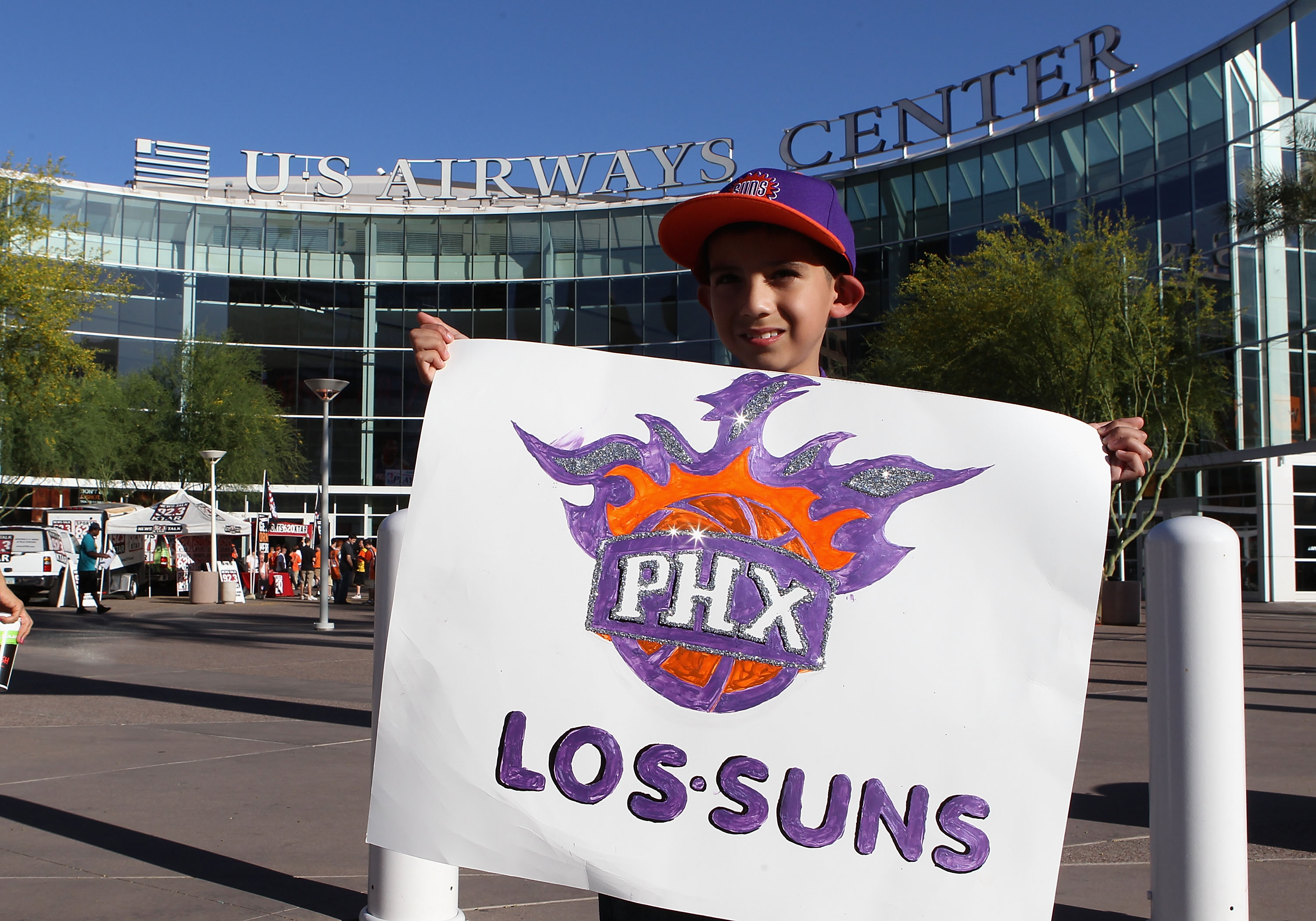 PHOENIX - MAY 05:  Phoenix Suns fan Isiah Quinonz poses with a 'Los Suns' sign before Game Two of the Western Conference Semifinals of the 2010 NBA Playoffs against the San Antonio Spurs at US Airways Center on May 5, 2010 in Phoenix, Arizona. The team is
