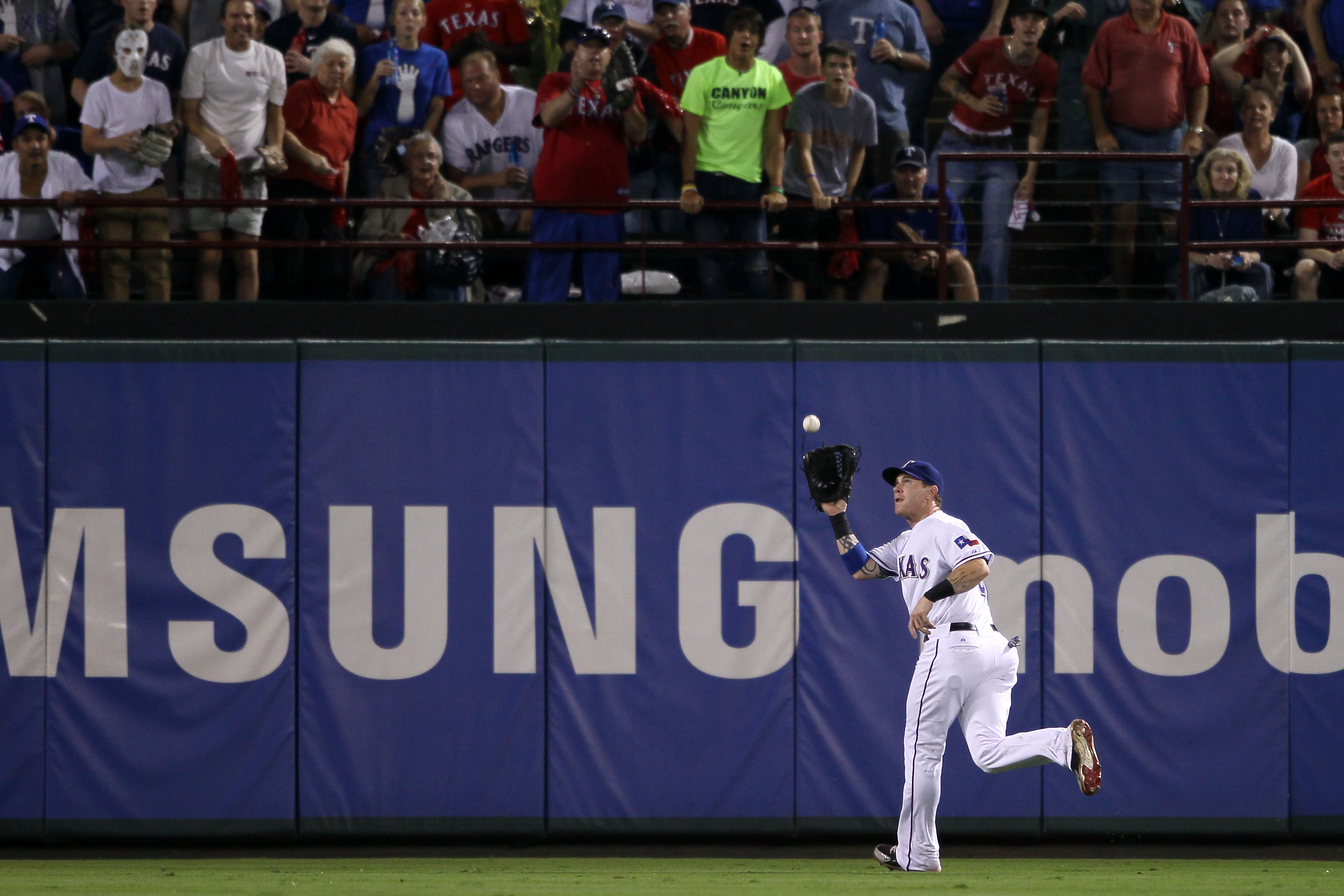 ARLINGTON, TX - OCTOBER 22:  Josh Hamilton #32 of the Texas Rangers makes a catch in the outfield against the New York Yankees in Game Six of the ALCS during the 2010 MLB Playoffs at Rangers Ballpark in Arlington on October 22, 2010 in Arlington, Texas.