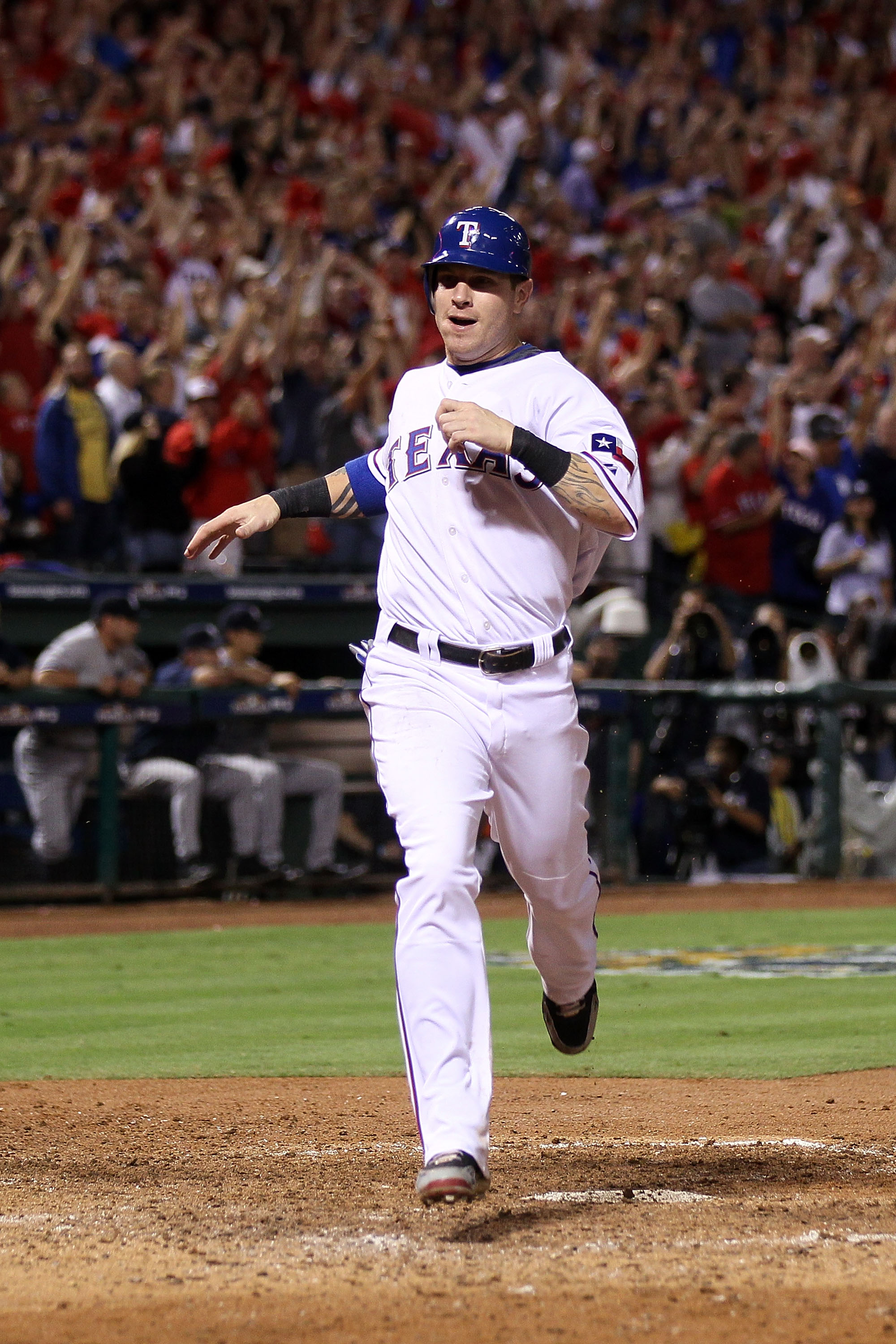 ARLINGTON, TX - OCTOBER 22:  Josh Hamilton #32 of the Texas Rangers crosses home plate to score in the fifth inning of Game Six of the ALCS against the New York Yankees during the 2010 MLB Playoffs at Rangers Ballpark in Arlington on October 22, 2010 in A