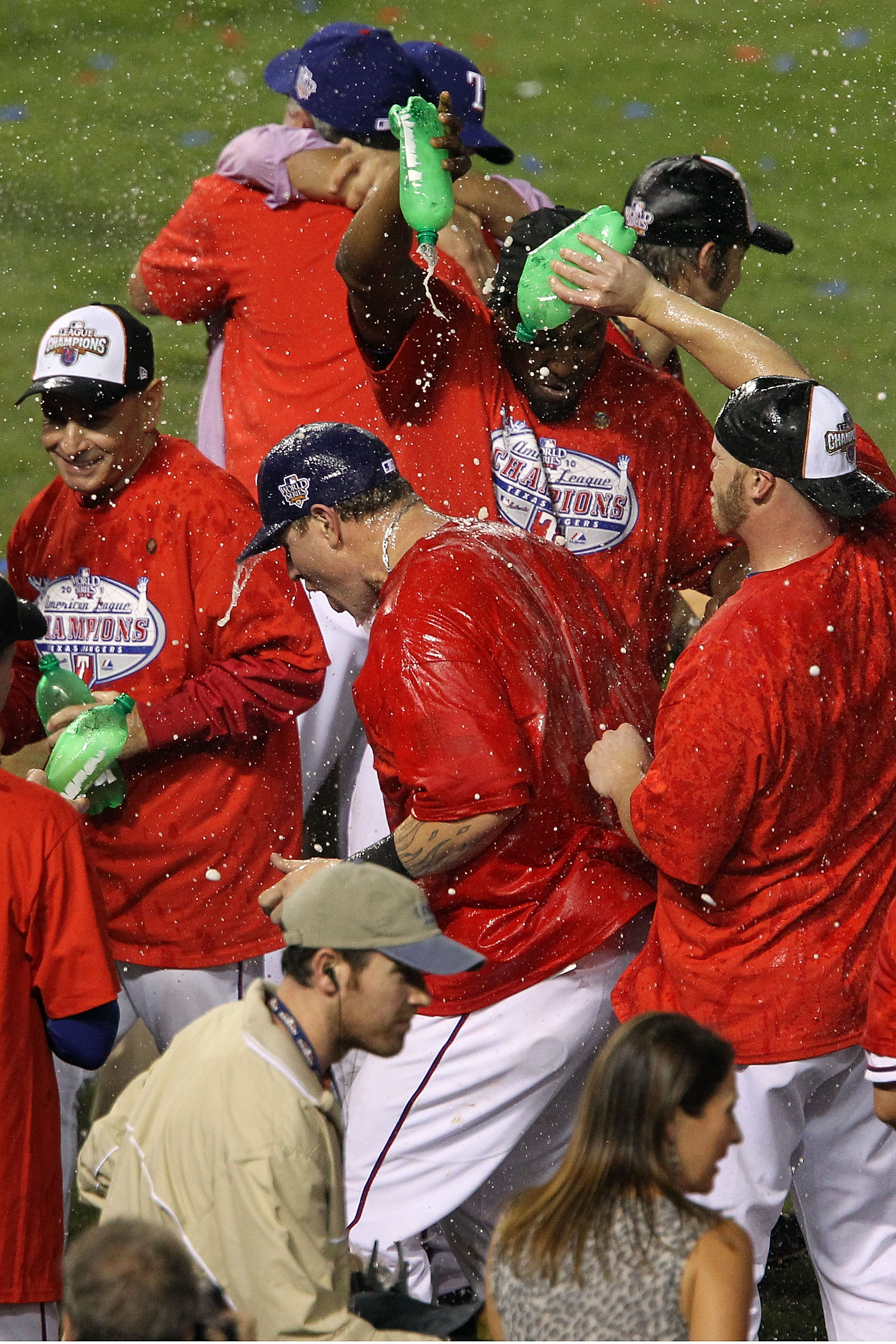 ARLINGTON, TX - OCTOBER 22:  Josh Hamilton #32 (C) of the Texas Rangers is sprayed with soda by teammates as they celebrate on the field after defeating the New York Yankees 6-1 in Game Six of the ALCS to advance to the World Series during the 2010 MLB Pl