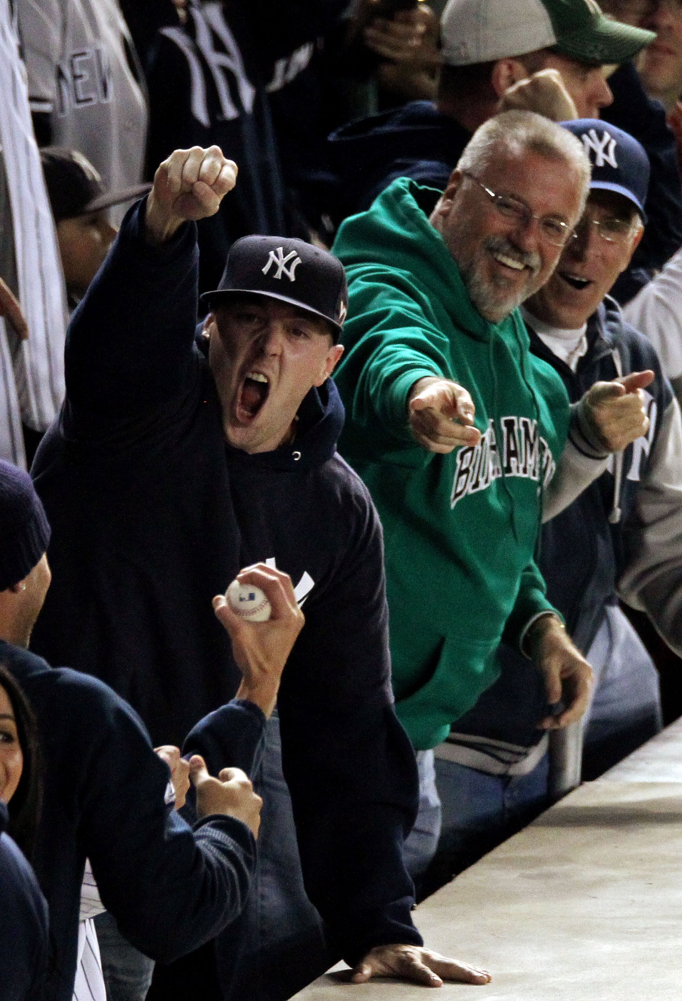 NEW YORK - OCTOBER 19:  A fan of the New York Yankees reacts after catching a home run ball hit by Robinson Cano #24 of the Yankees in the bottom of the seocnd inning against the Texas Rangers in Game Four of the ALCS during the 2010 MLB Playoffs at Yanke