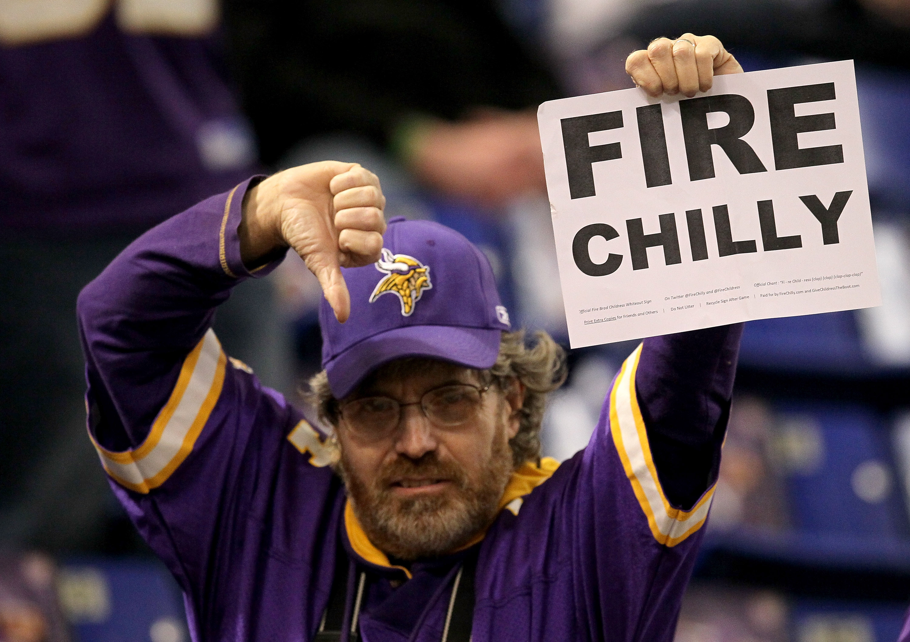 MINNEAPOLIS - NOVEMBER 07:  A Minnesota Vikings fan holds up a sign urging the firing of Vikings head coach rad Childress before the game with the Arizona Cardinals at Hubert H. Humphrey Metrodome on November 7, 2010 in Minneapolis, Minnesota.  (Photo by