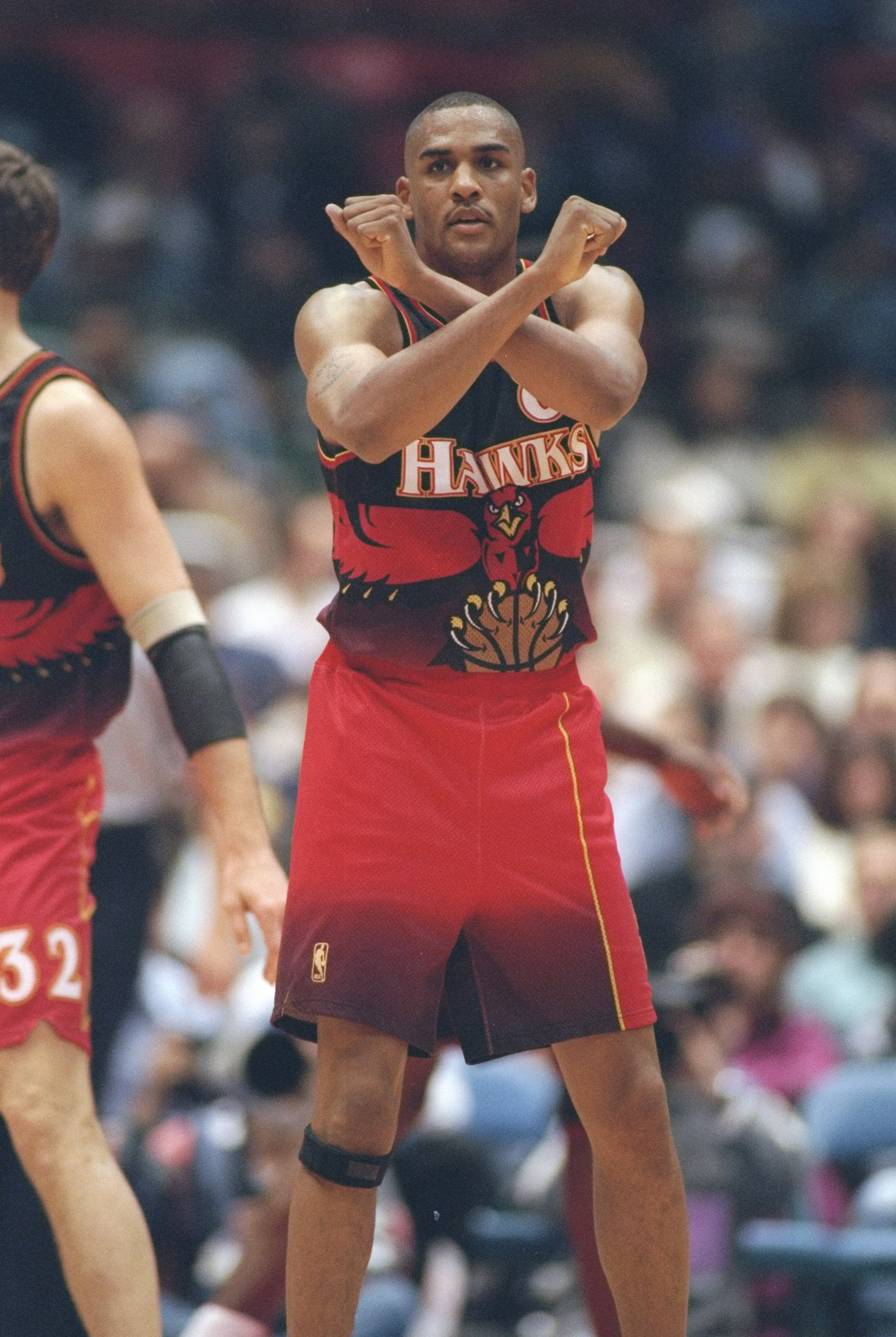 df474f32712 3 Jan 1997  Guard Steve Smith of the Atlanta Hawks gives signals during a  game