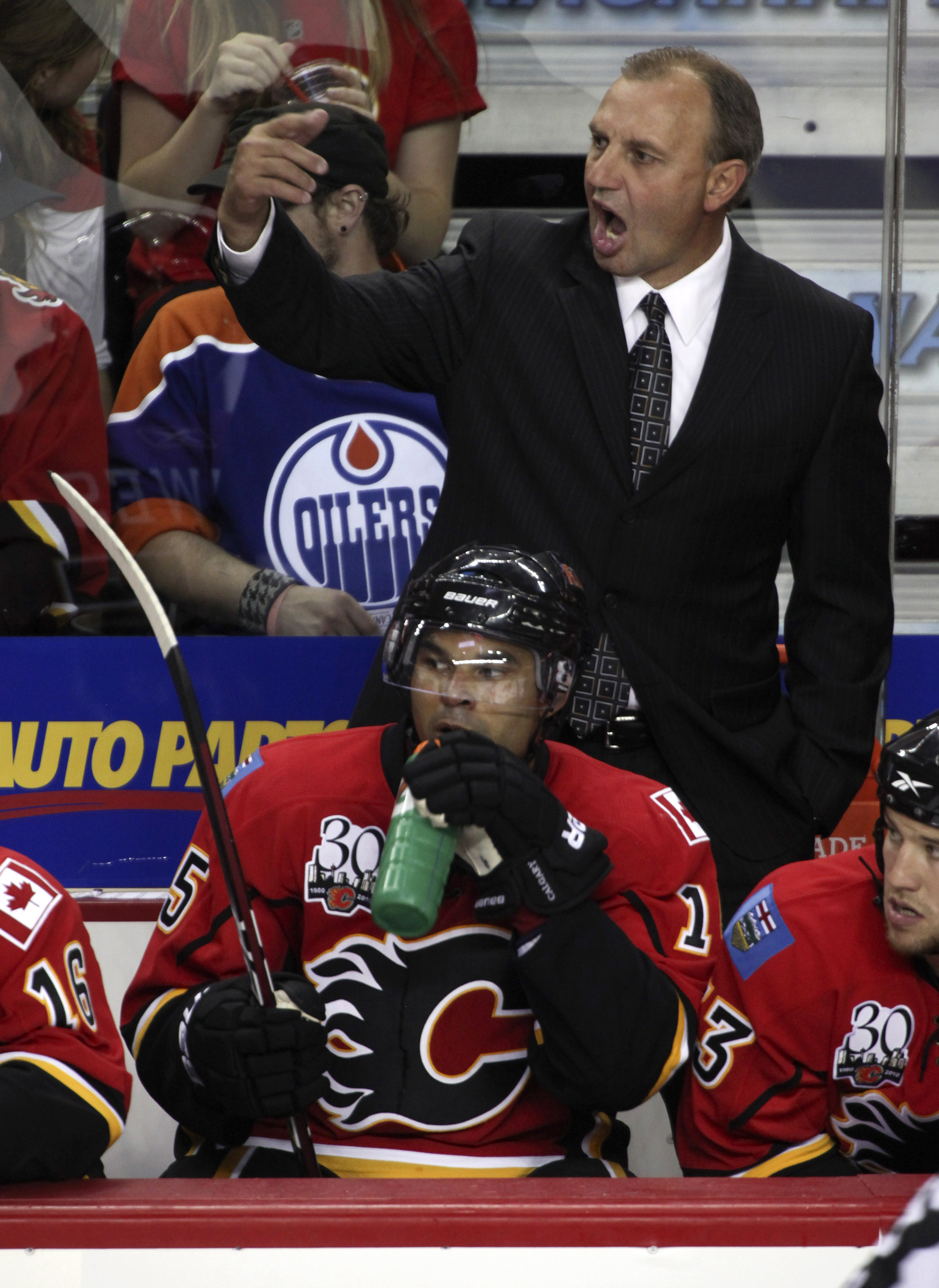 CALGARY, CANADA - SEPTEMBER 15: Head coach Brent Sutter of the Calgary Flames yells from the bench during the third period against the Edmonton Oilers in NHL preseason action on September 15, 2009 at the Pengrowth Saddledome in Calgary, Alberta, Canada. (