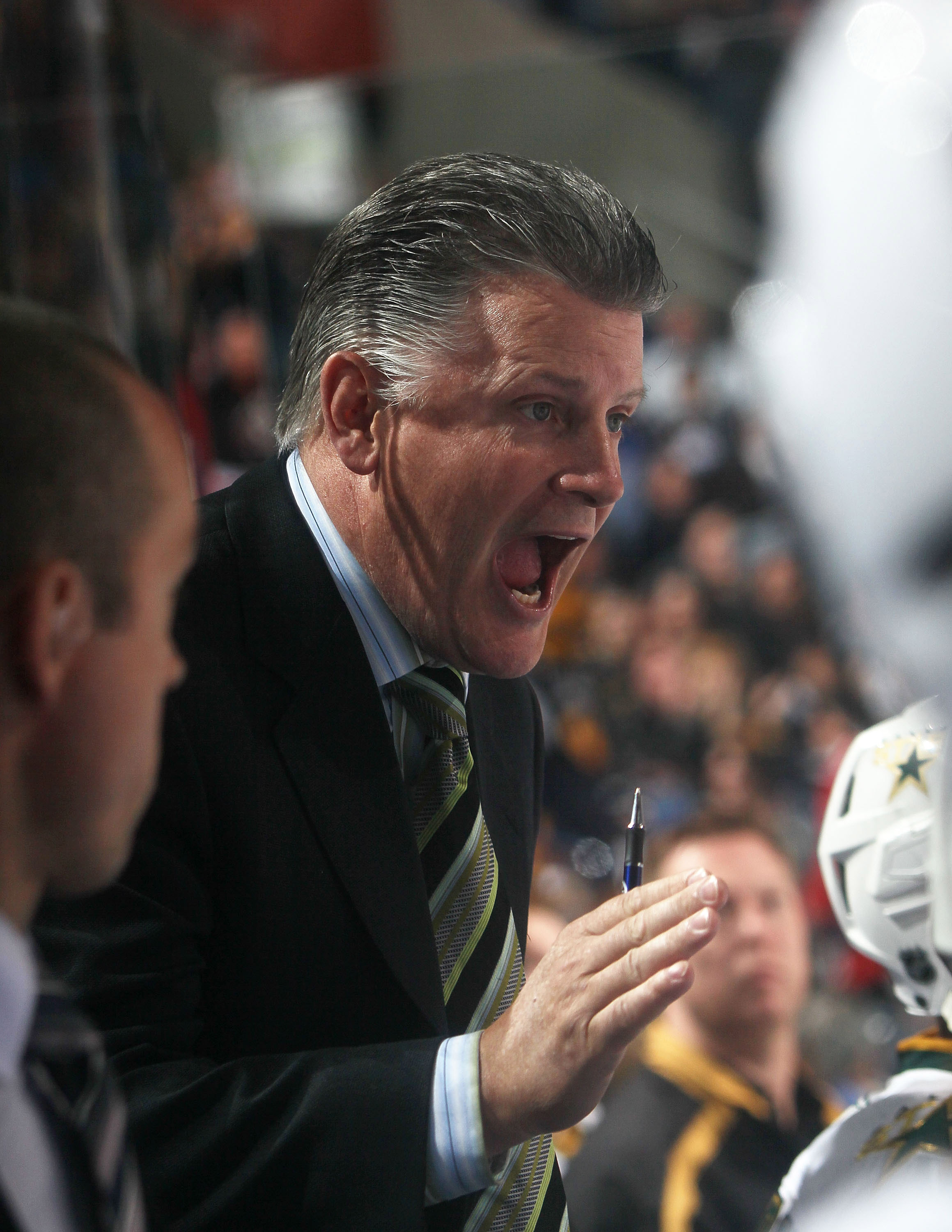 BUFFALO, NY - MARCH 10: Head coach Marc Crawford of the Dallas Stars gives last-minute instructions to his team during the game against the Buffalo Sabres at the HSBC Arena on March 10, 2010 in Buffalo, New York. The Sabres defeated the Stars 5-3. (Photo