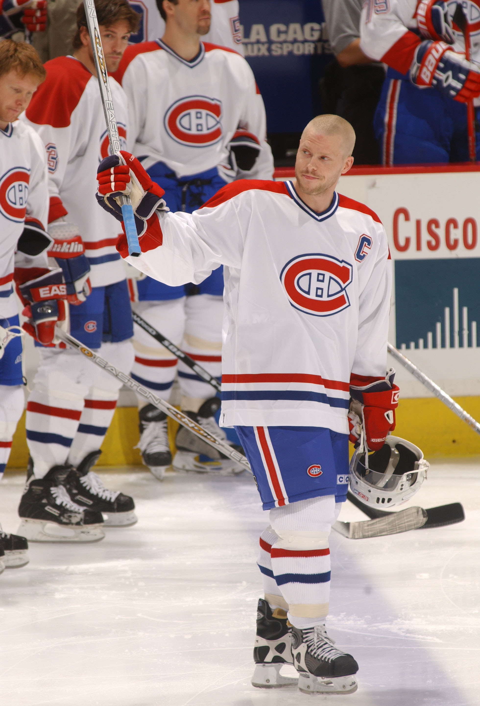 9 Apr 2002:  Saku Koivu #11 of the Montreal Canadiens waves to the crowd as he recieves a standing ovation at the start of the game against the Ottowa Senators at the Molson Centre in Montreal, Canada. DIGITAL IMAGE Mandatory credit: Dave Sandford/GettyIm