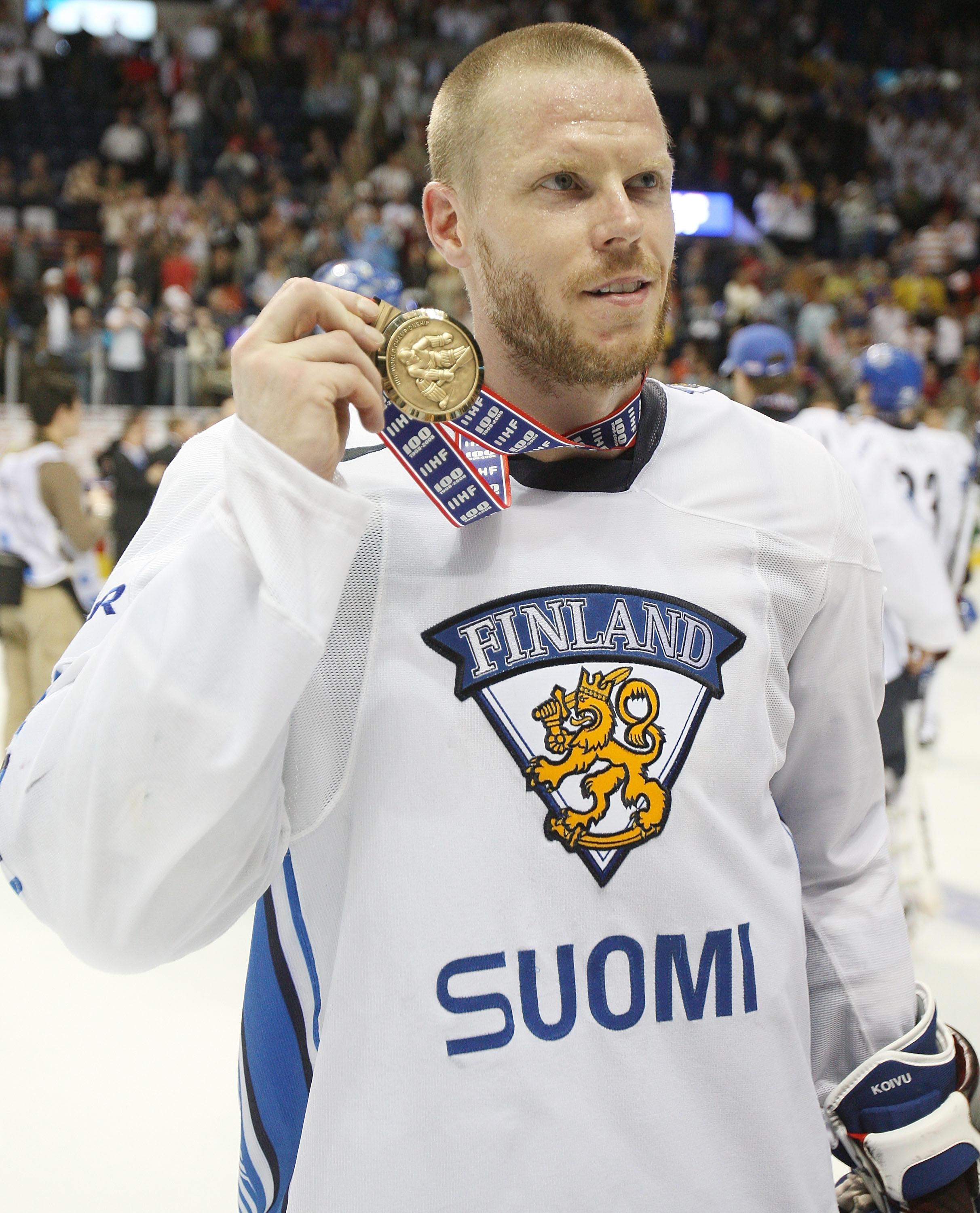 QUEBEC CITY, CANADA - MAY 17: Saku Koivu #11 of Finland shows off his bronze medal after Finland won the Bronze Medal Game of the International Ice Hockey Federation World Championship at the Colisee Pepsi on May 17, 2008 in Quebec City, Canada.  (Photo b
