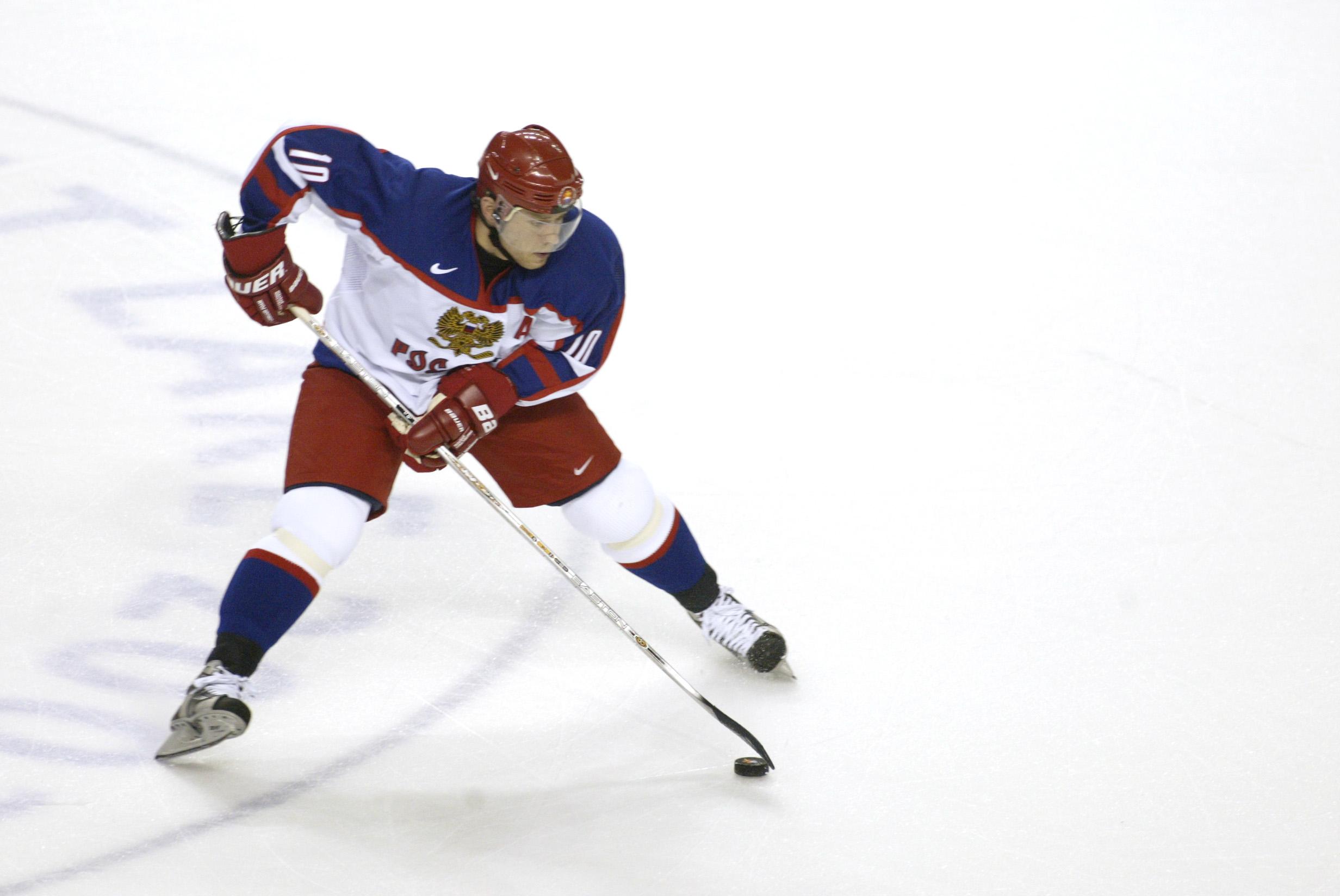 22 Feb 2002:   Pavel Bure #10 of Russia skates through center ice during men's semifinals at the Salt Lake City Winter Olympic Games at the E Center in Salt Lake City, Utah. DIGITAL IMAGE. Mandatory Credit:   Adam Pretty/Getty Images