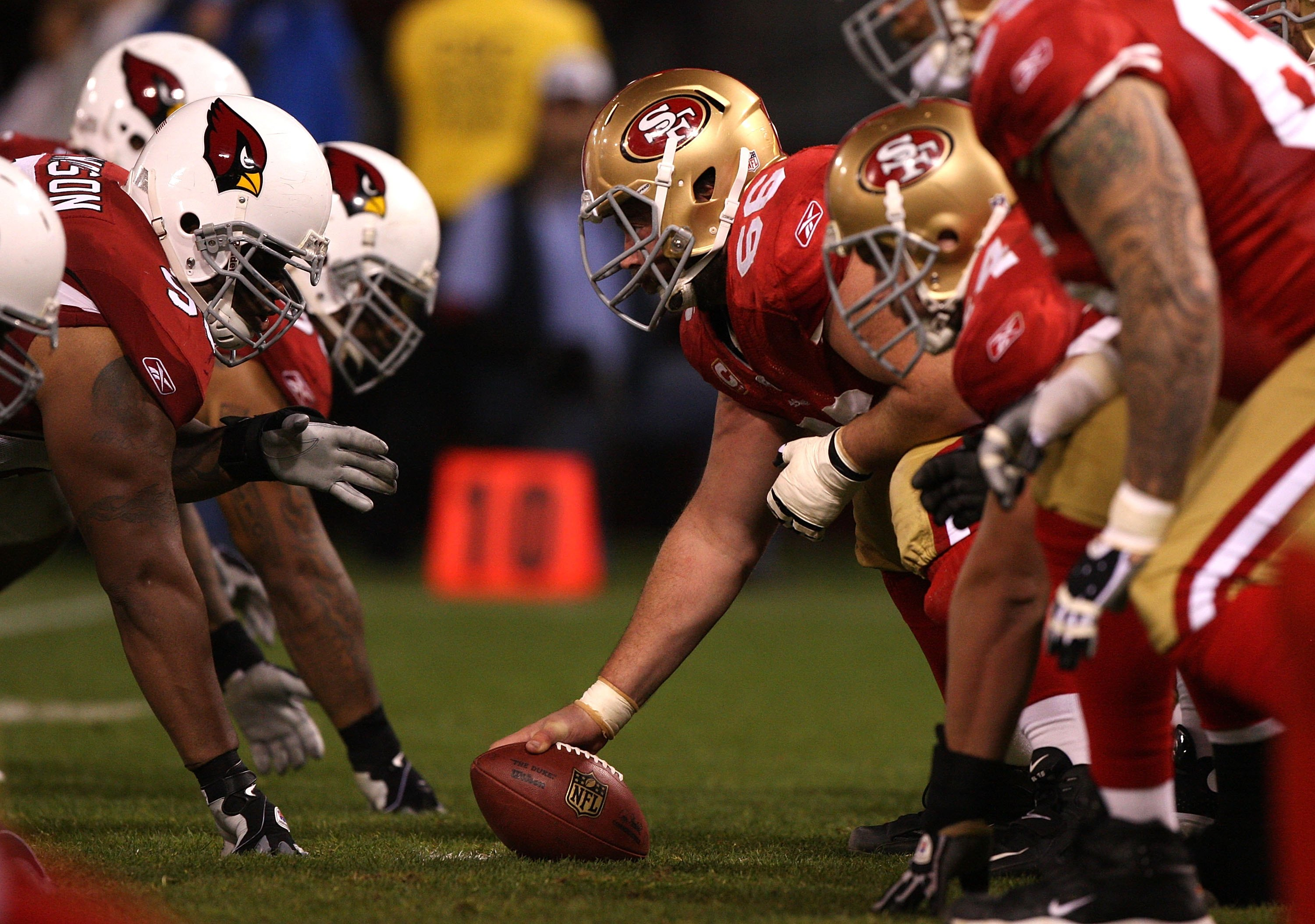 SAN FRANCISCO - DECEMBER 14:  Members of the San Francisco 49ers in action against the Arizona Cardinals at Candlestick Park on December 14, 2009 in San Francisco, California.  (Photo by Jed Jacobsohn/Getty Images)
