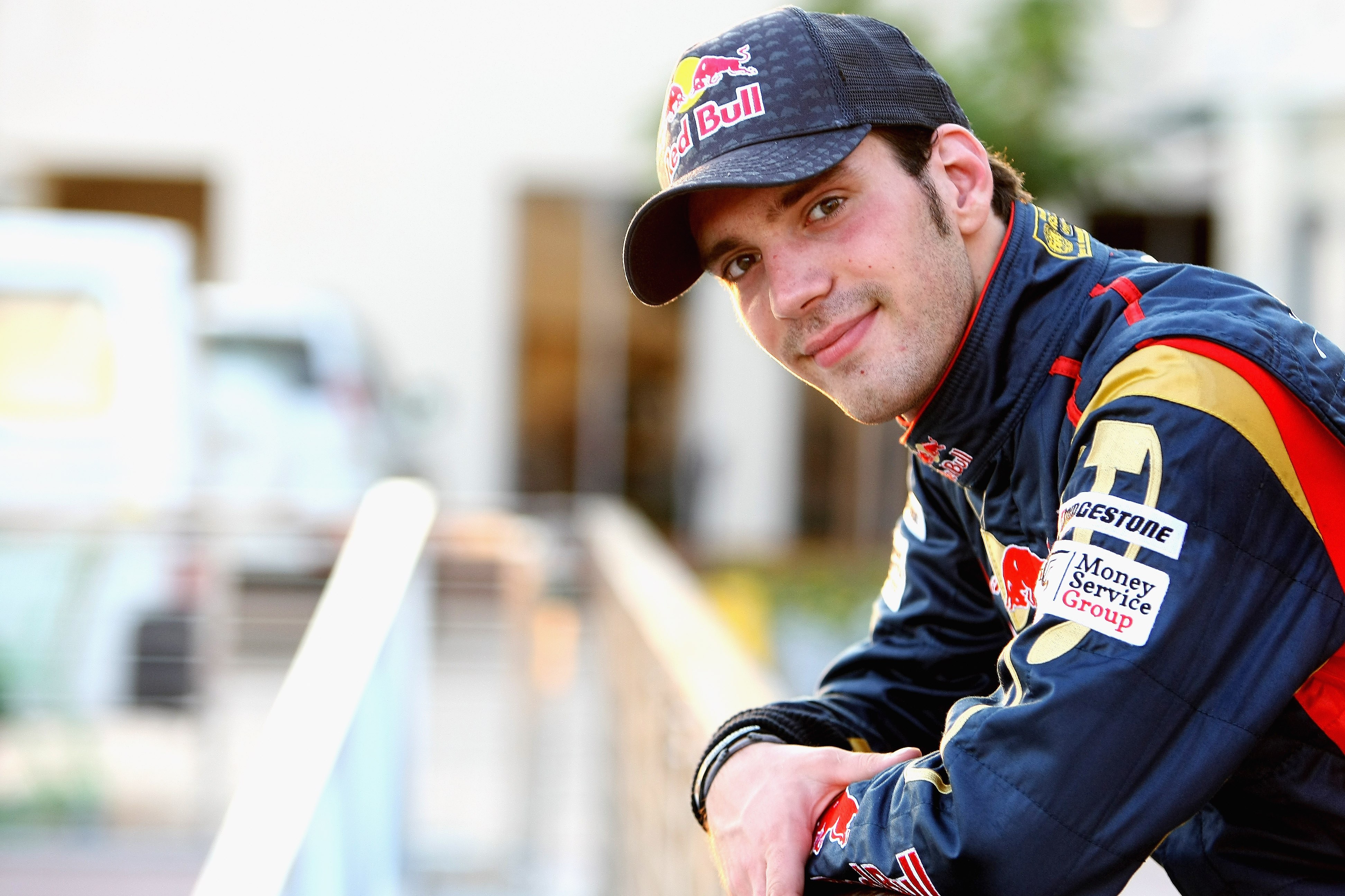 ABU DHABI, UNITED ARAB EMIRATES - NOVEMBER 16:  Jean-Eric Vergne of France and Scuderia Toro Rosso poses for a picture during the Young Driver Testing at the Yas Marina Circuit on November 16, 2010 in Abu Dhabi, United Arab Emirates.  (Photo by Andrew Hon
