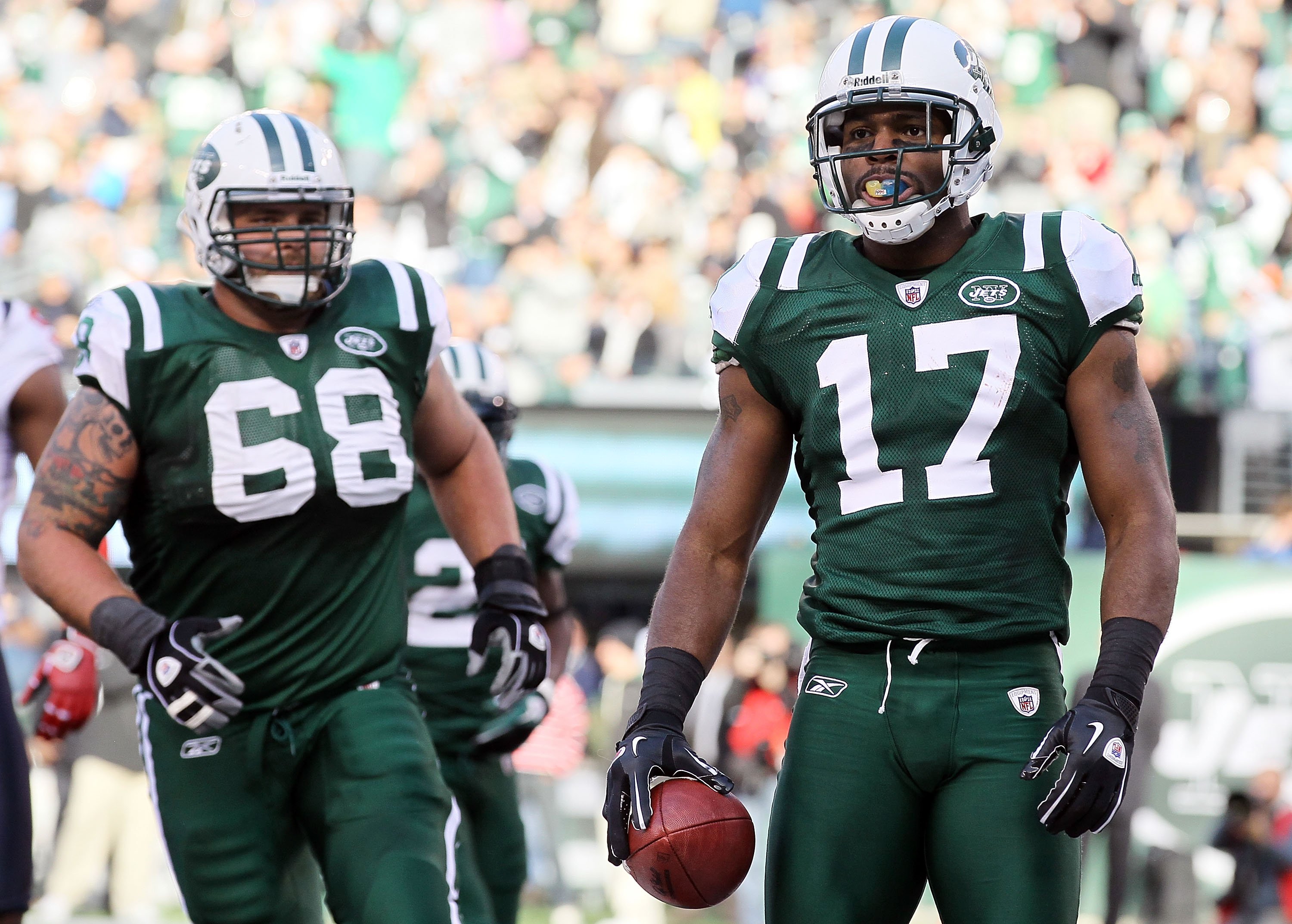 EAST RUTHERFORD, NJ - NOVEMBER 21: Braylon Edwards #17 of the New York Jets looks on after scoring a touchdown agianst the Houston Texans as teammate Matt Saluson #68 looks on November 21, 2010 at the New Meadowlands Stadium in East Rutherford, New Jersey