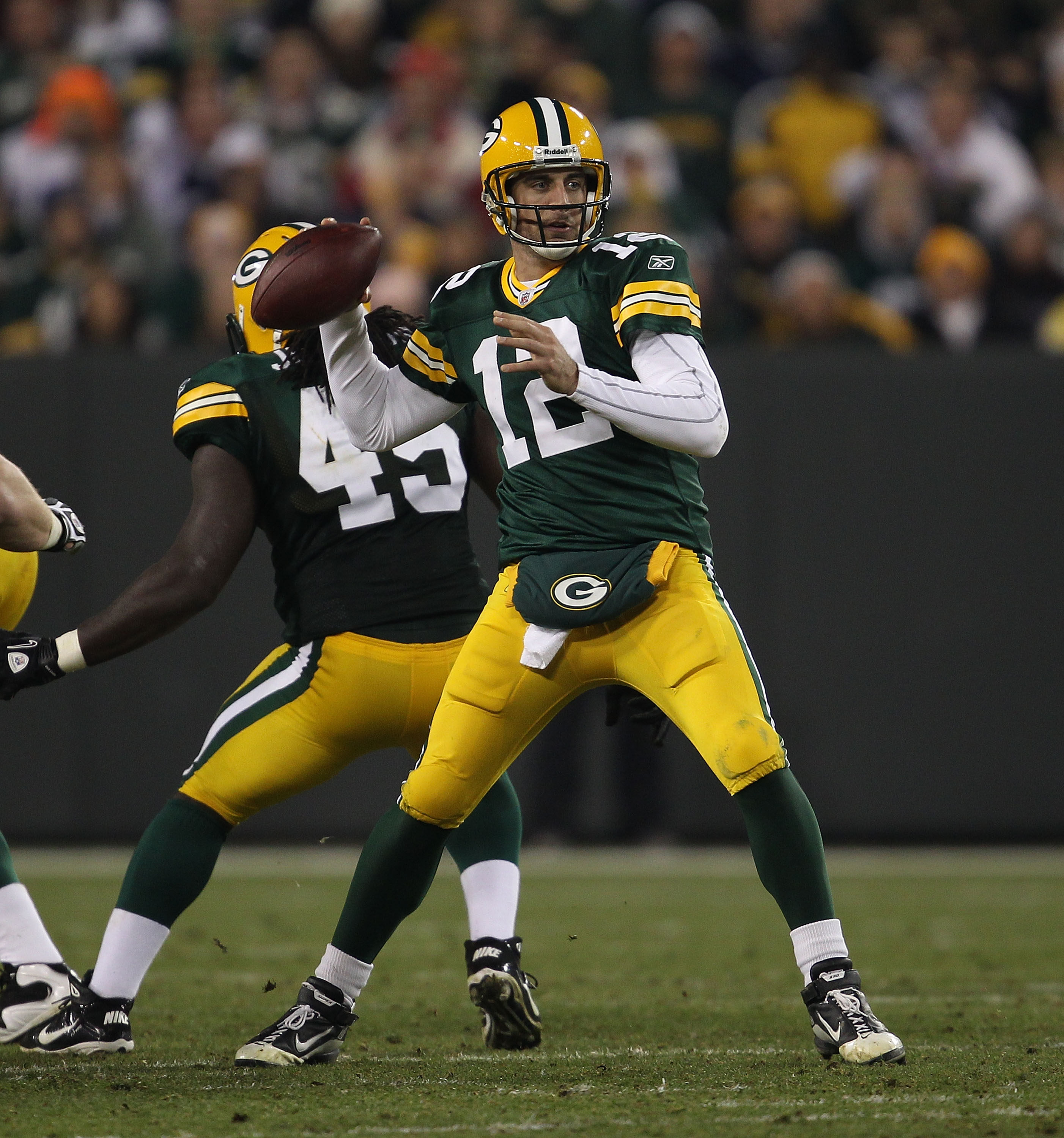 GREEN BAY, WI - NOVEMBER 07: Aaron Rodgers #12 of the Green Bay Packers throws a pass against the Dallas Cowboys at Lambeau Field on November 7, 2010 in Green Bay, Wisconsin. The Packers defeated the Cowboys 45-7. (Photo by Jonathan Daniel/Getty Images)