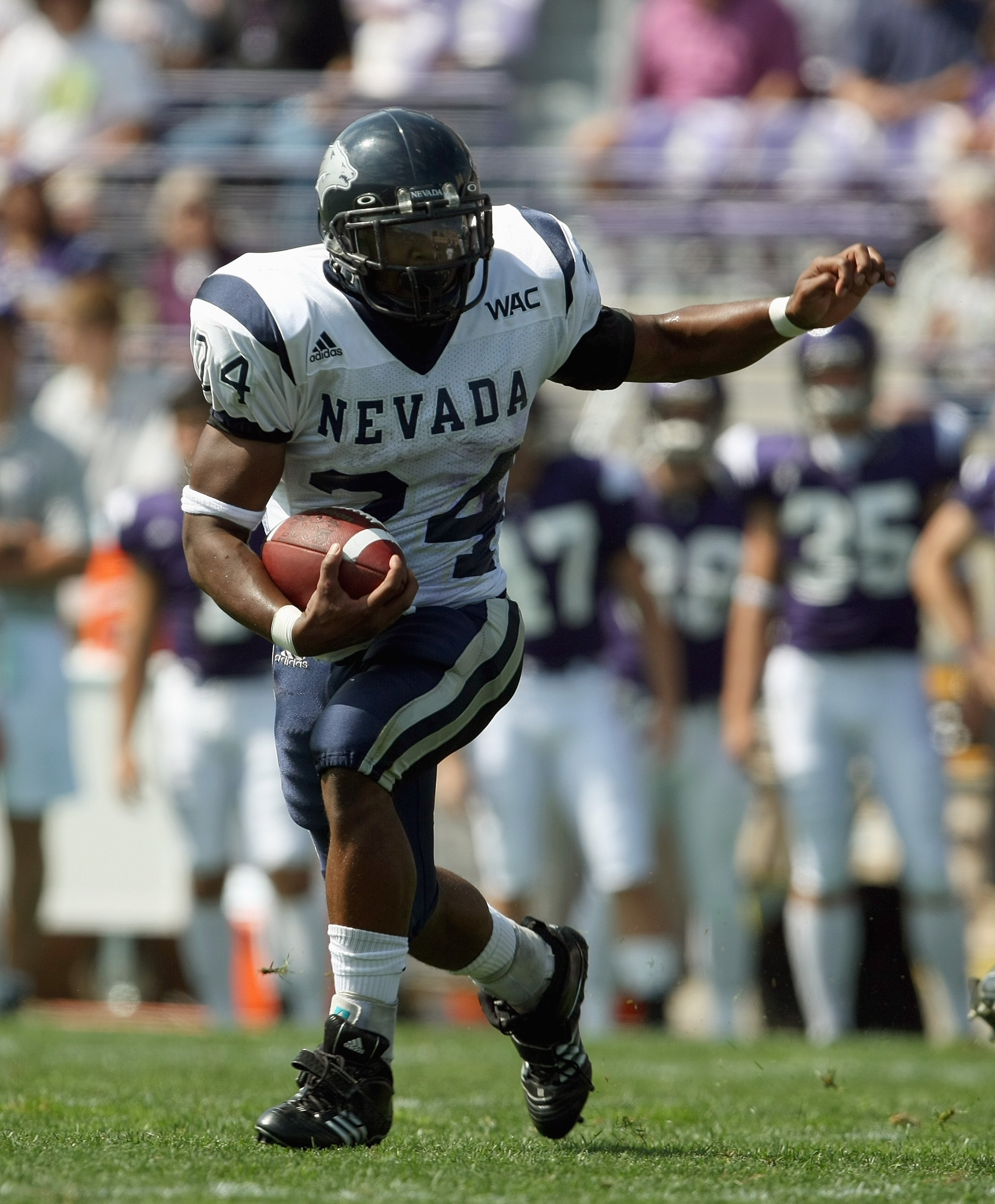 EVANSTON, IL - SEPTEMBER 8:  Brandon Fragger #24 of the Nevada Wolf Pack carries the ball against the Northwestern Wildcats on September 8, 2007 at Ryan Field at Northwestern University in Evanston, Illinois. (Photo by Jonathan Daniel/Getty Images)