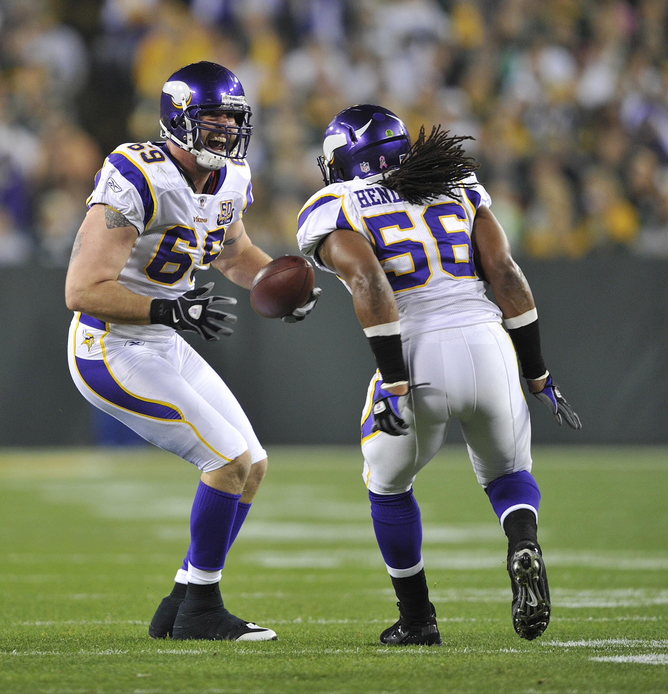 GREEN BAY, WI - OCTOBER 24:  Jared Allen #69 of the Minnesota Vikings celebrates with E.J. Henderson #56 after Allens' interception against the Green Bay Packers at Lambeau Field on October 24, 2010 in Green Bay, Wisconsin. (Photo by Jim Prisching/Getty I