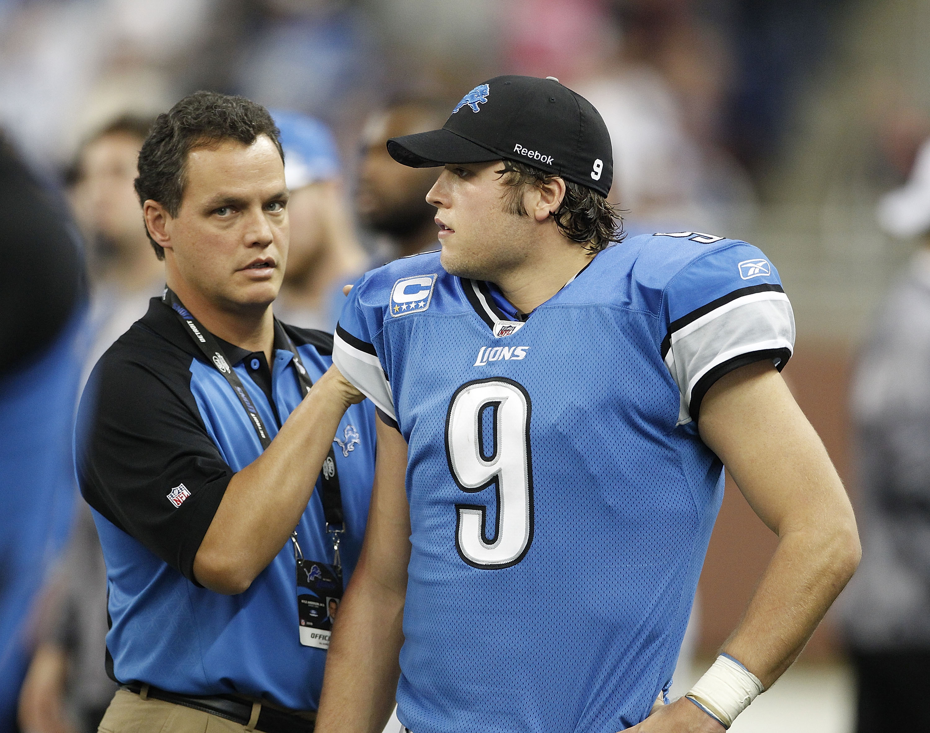 DETROIT - NOVEMBER 07: Detroit Lions team doctor Kyle Anderson checks the right shoulder of Matthew Stafford #9 of the Detroit Lions after leaving the game during the third quarter of the game at Ford Field on November 7, 2010 in Detroit, Michigan. The Je