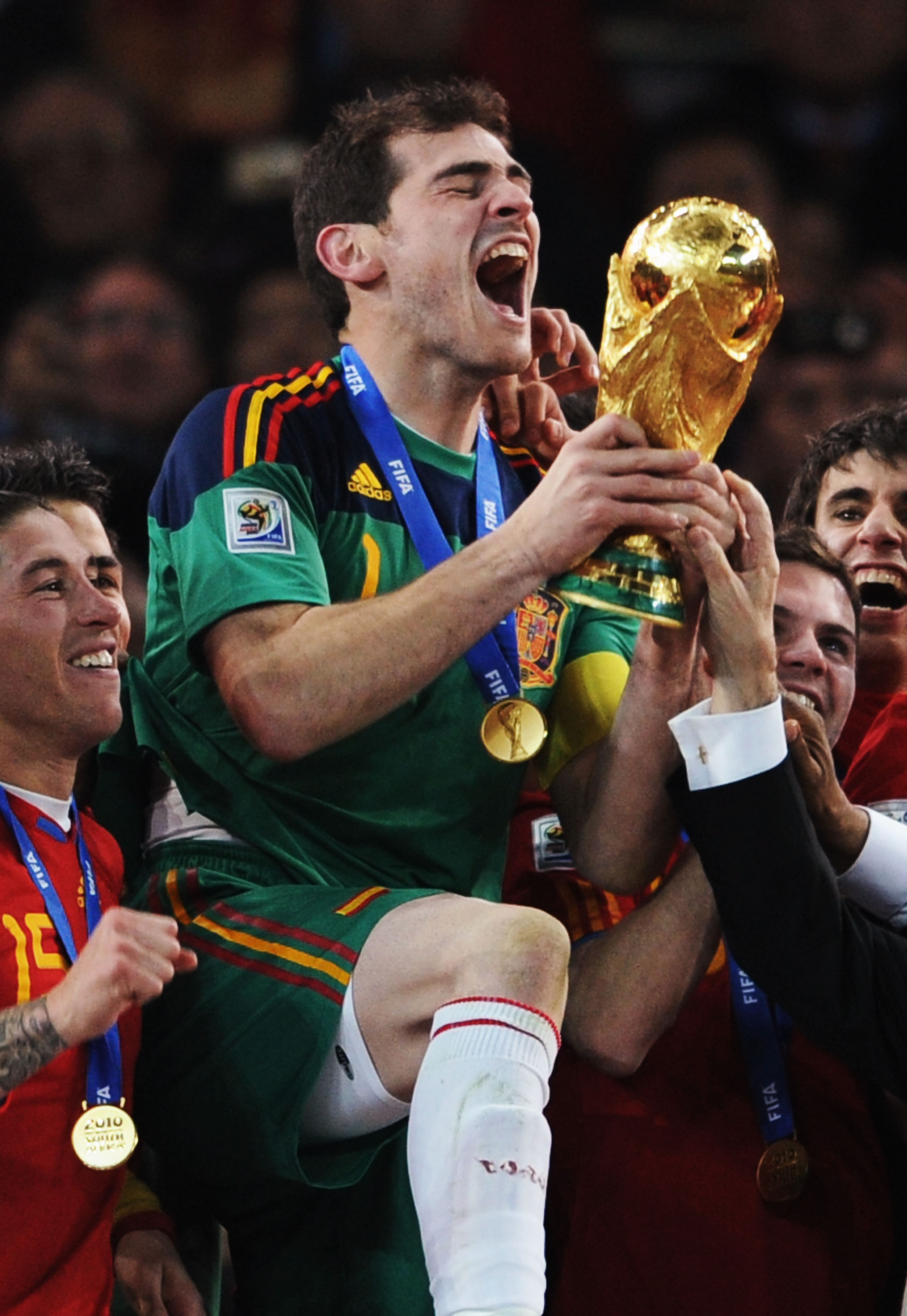 JOHANNESBURG, SOUTH AFRICA - JULY 11:  Iker Casillas, captain of Spain (C), and the Spain team celebrate victory with the World Cup trophy following the 2010 FIFA World Cup South Africa Final match between Netherlands and Spain at Soccer City Stadium on J