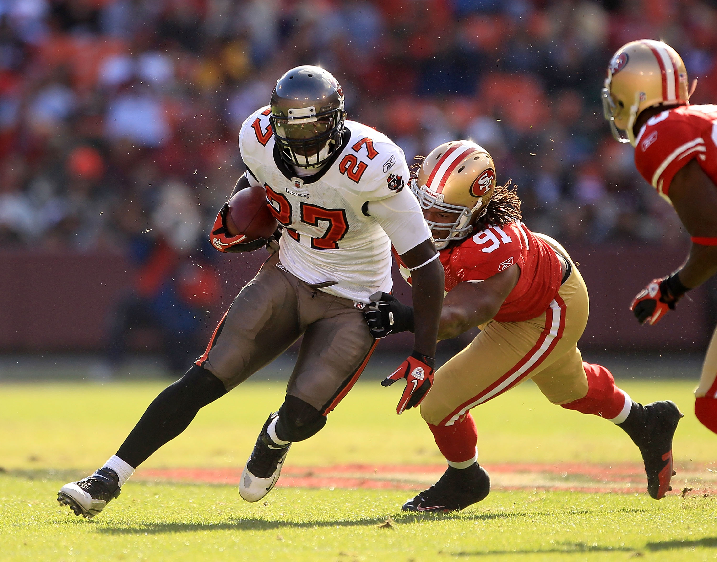 SAN FRANCISCO - NOVEMBER 21:  LeGarrette Blount #27 of the Tampa Bay Buccaneers is tackled by the Ray McDonald #91 of the San Francisco 49ers at Candlestick Park on November 21, 2010 in San Francisco, California.  (Photo by Ezra Shaw/Getty Images)