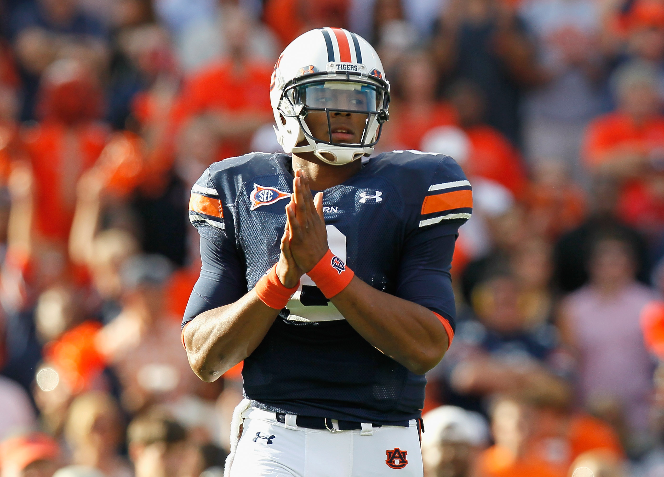 AUBURN, AL - NOVEMBER 13:  Quarterback Cameron Newton #2 of the Auburn Tigers walks onto the field for the first offensive series against the Georgia Bulldogs at Jordan-Hare Stadium on November 13, 2010 in Auburn, Alabama.  (Photo by Kevin C. Cox/Getty Im