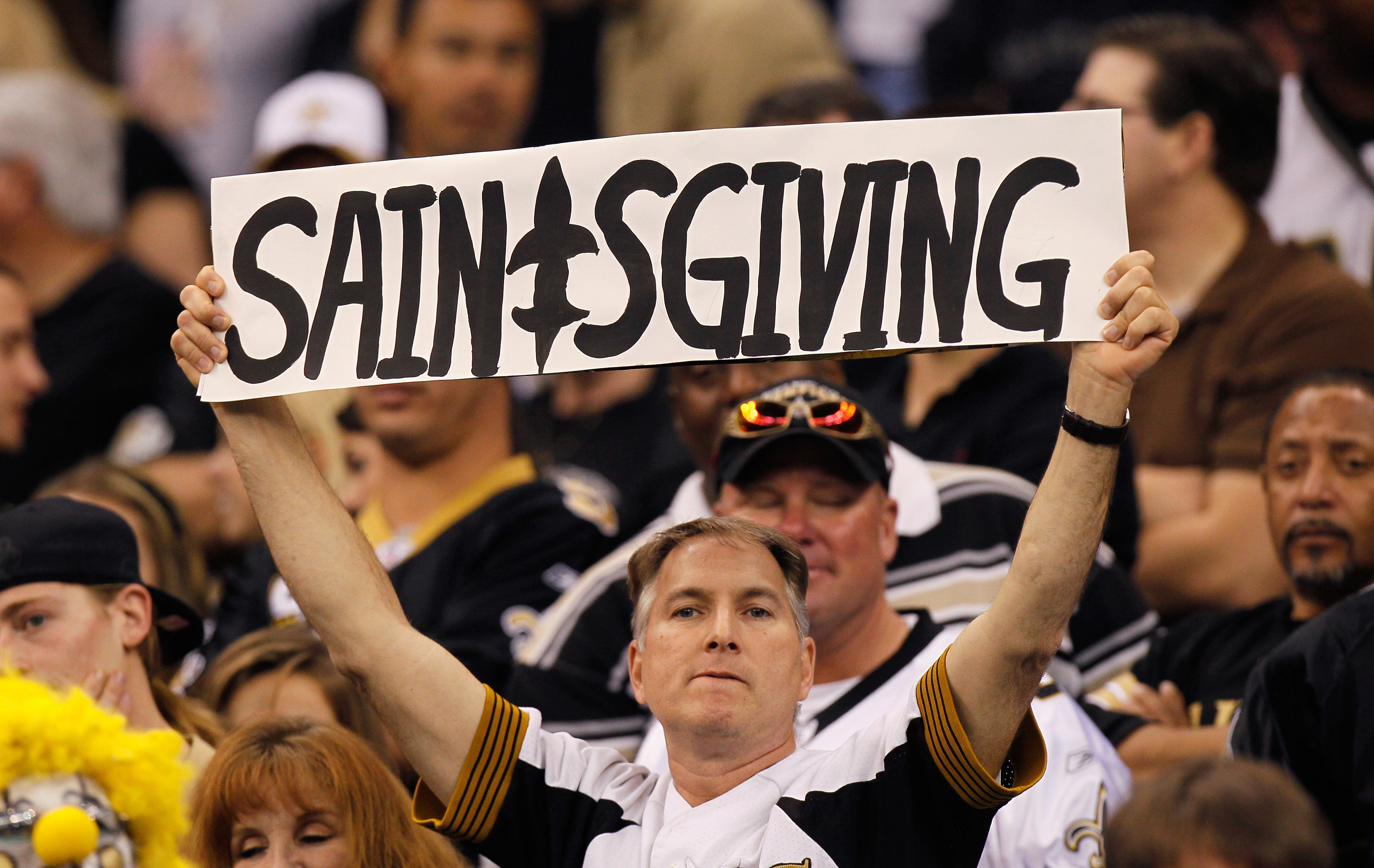 NEW ORLEANS - NOVEMBER 21:  A fan of the New Orleans Saints holds up a sign for 'Saintsgiving' during the sign against the Seattle Seahawks at Louisiana Superdome on November 21, 2010 in New Orleans, Louisiana.  (Photo by Kevin C. Cox/Getty Images)