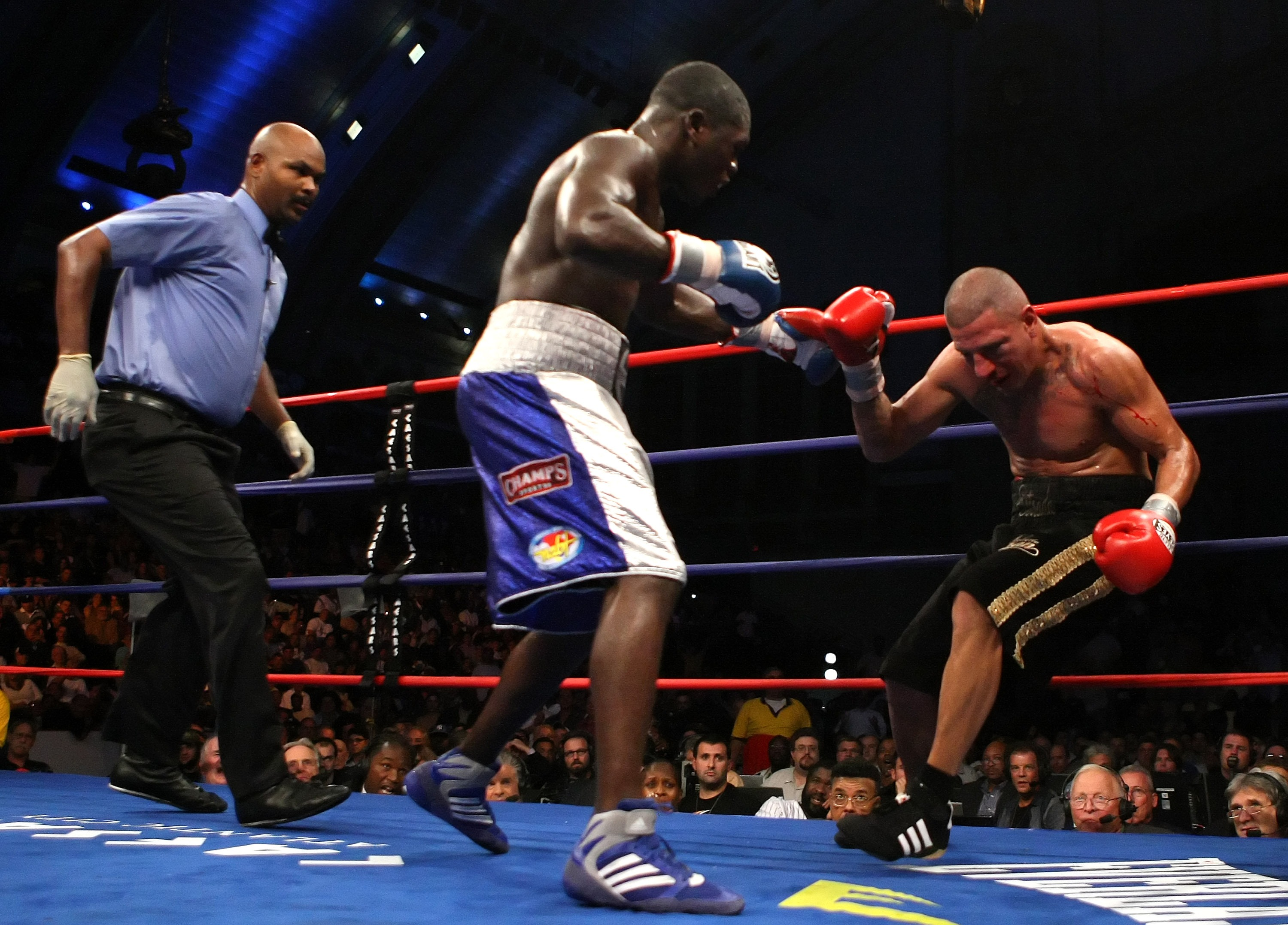 ATLANTIC CITY, NJ - SEPTEMBER 29:  David Estrada falls against the ropes after receiving a blow from Andre Berto during their NABF Welterweight Championship fight at Boardwalk Hall on September 29, 2007 in Atlantic City, New Jersey.  Andre Berto won by TK
