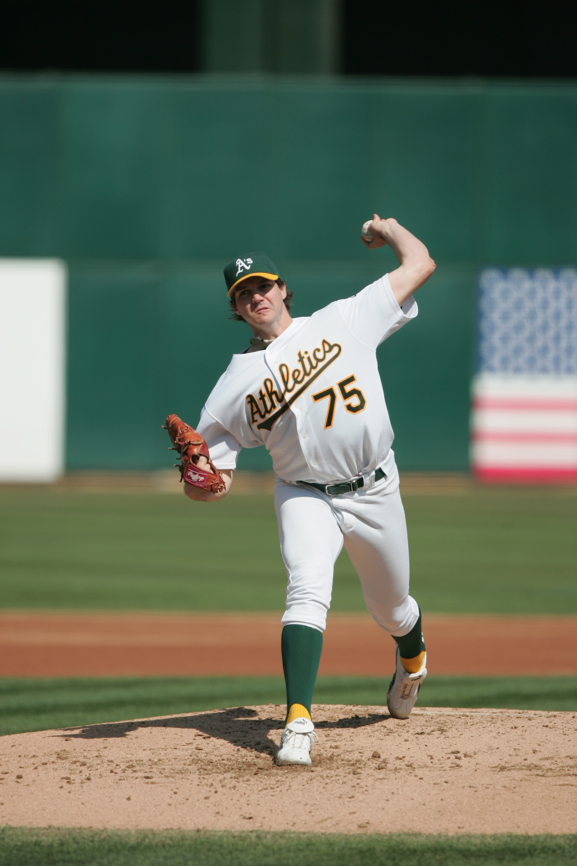 OAKLAND, CA - OCTOBER 2:  Pitcher Barry Zito #75 of the Oakland Athletics delivers a pitch against the Anaheim Angels during a MLB game at the Network Associates Coliseum on October 2, 2004 in Oakland, California. The Angeles won 5-4.  (Photo by Jed Jacob