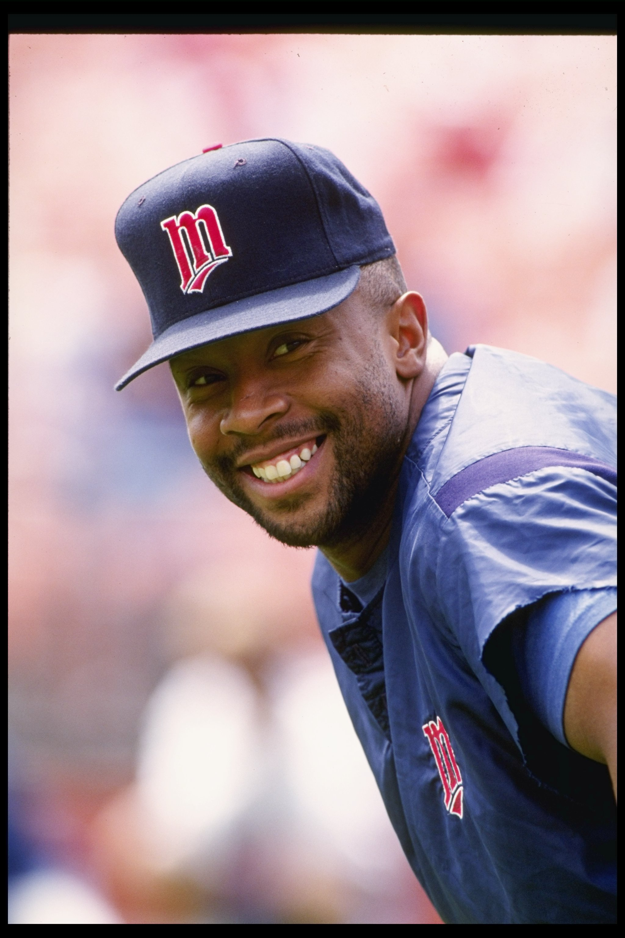 25 Jul 1992:  Outfielder Kirby Puckett of the Minnesota Twins smiles at the camera during a game against the Oakland Athletics at Oakland Alameda County Coliseum in Oakland, California.  Mandatory Credit: Otto Greule Jr.  /Allsport