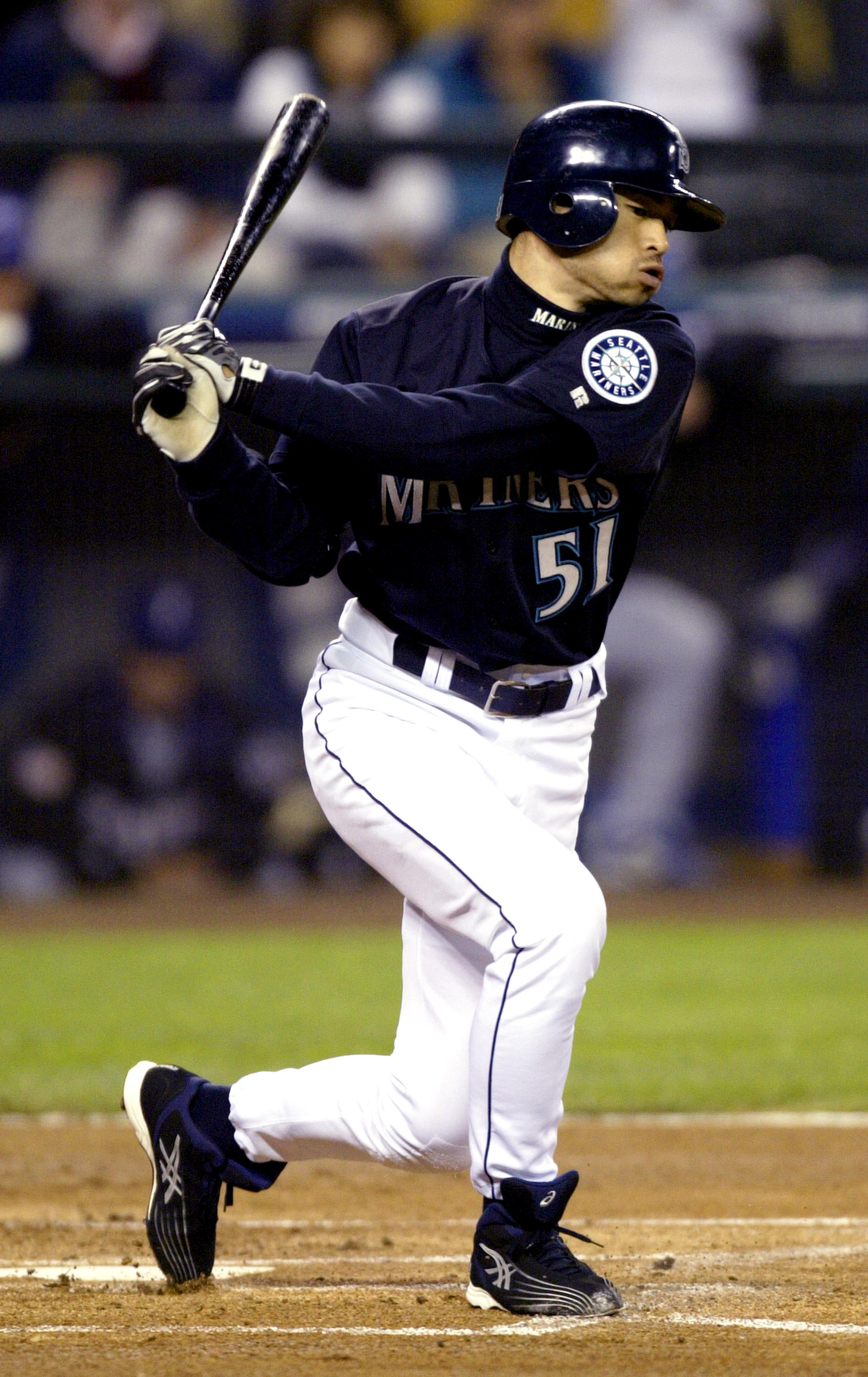 SEATTLE - OCTOBER 1:  Outfielder Ichiro Suzuki #51 of the Seattle Mariners connects with a Texas Rangers pitch and ties George Sisler's 84-year-old record for hits in a single season, during the game on October 1, 2004 at Safeco Field in Seattle, Washingt