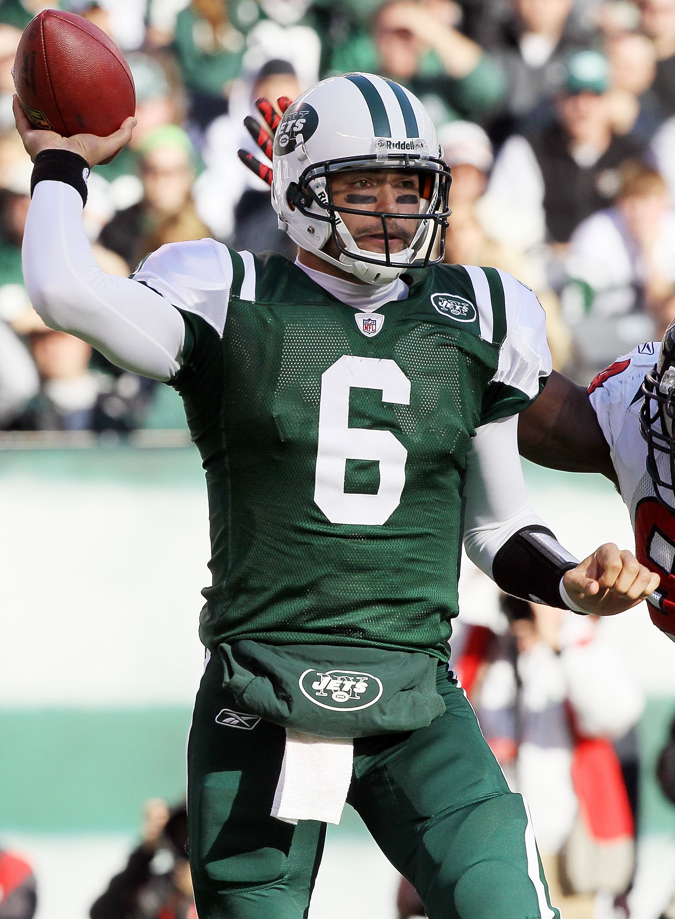 EAST RUTHERFORD, NJ - NOVEMBER 21:  Mark Sanchez #6 of the New York Jets looks to throw a pass against the Houston Texans on November 21, 2010 at the New Meadowlands Stadium in East Rutherford, New Jersey.  (Photo by Jim McIsaac/Getty Images)
