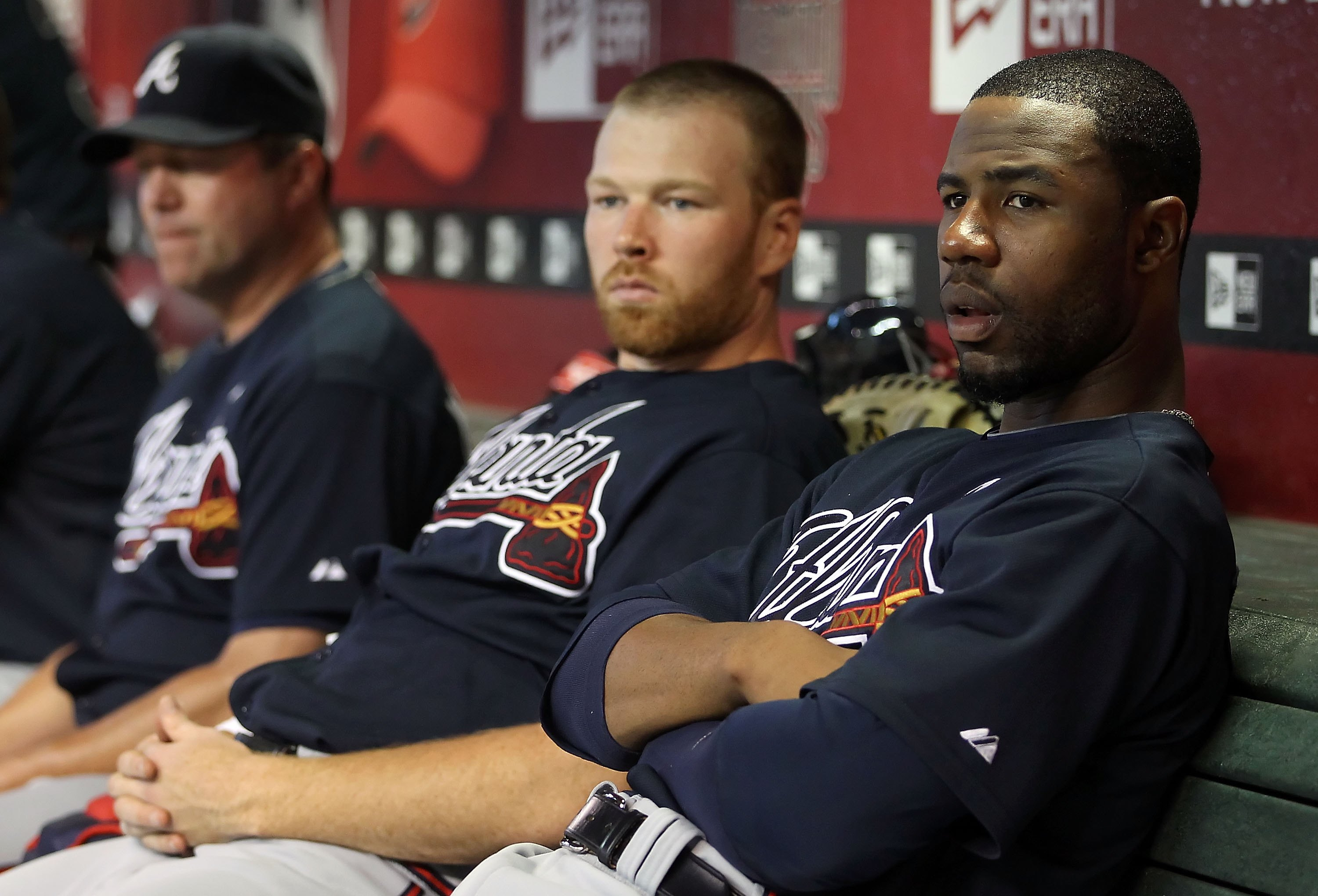 PHOENIX - JUNE 10:  Jason Heyward #22 (R) and pitcher Tommy Hanson #48 of the Atlanta Braves sit in the dugout during the Major League Baseball game against the Arizona Diamondbacksat Chase Field on June 10, 2010 in Phoenix, Arizona.  The Braves defeated