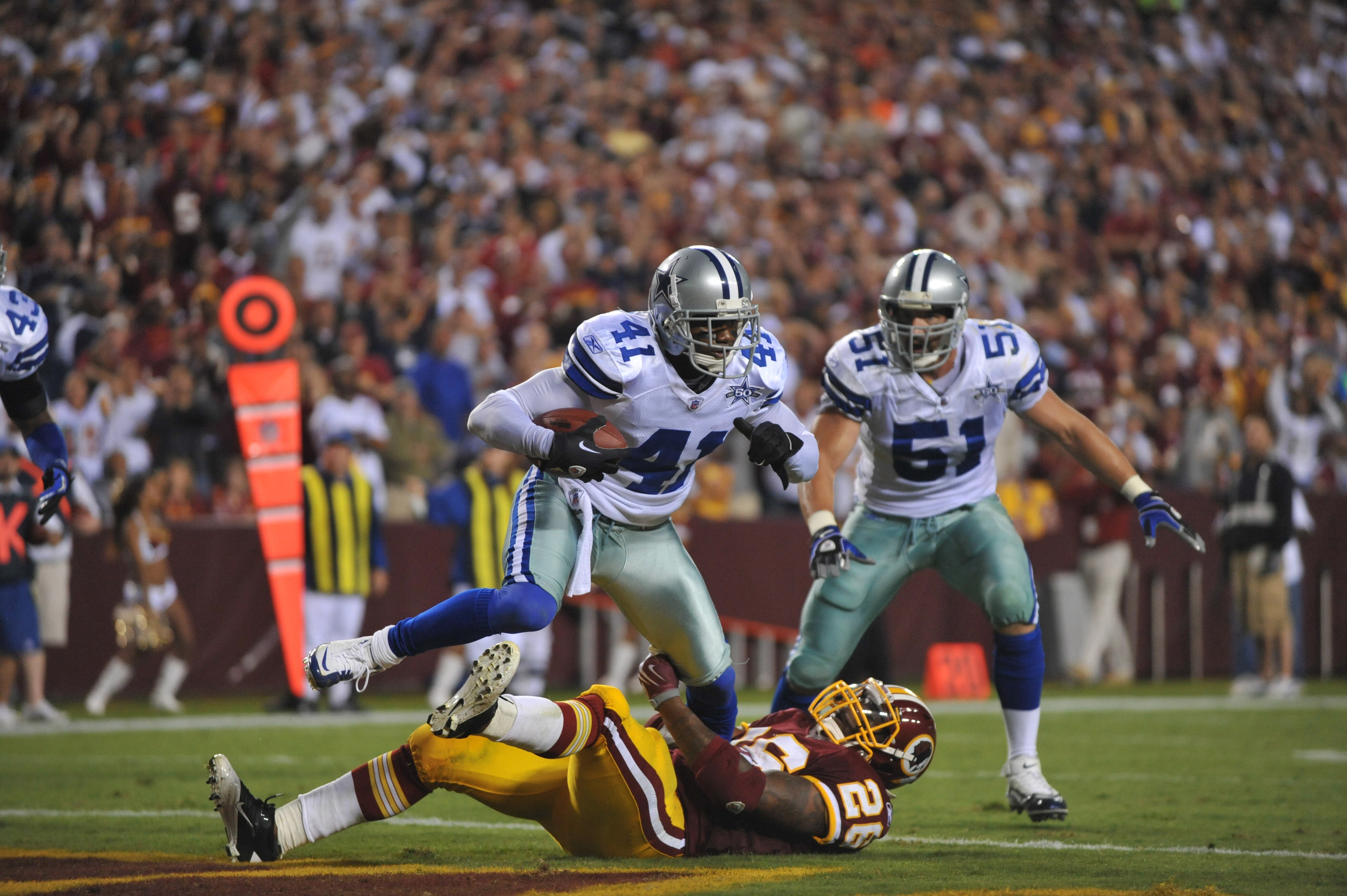 LANDOVER - SEPTEMBER 12:  Terence Newman #41 of the Dallas Cowboys makes an apparent interception on a play called back during the NFL season opener against the Washington Redskins at FedExField on September 12, 2010 in Landover, Maryland. The Redskins de