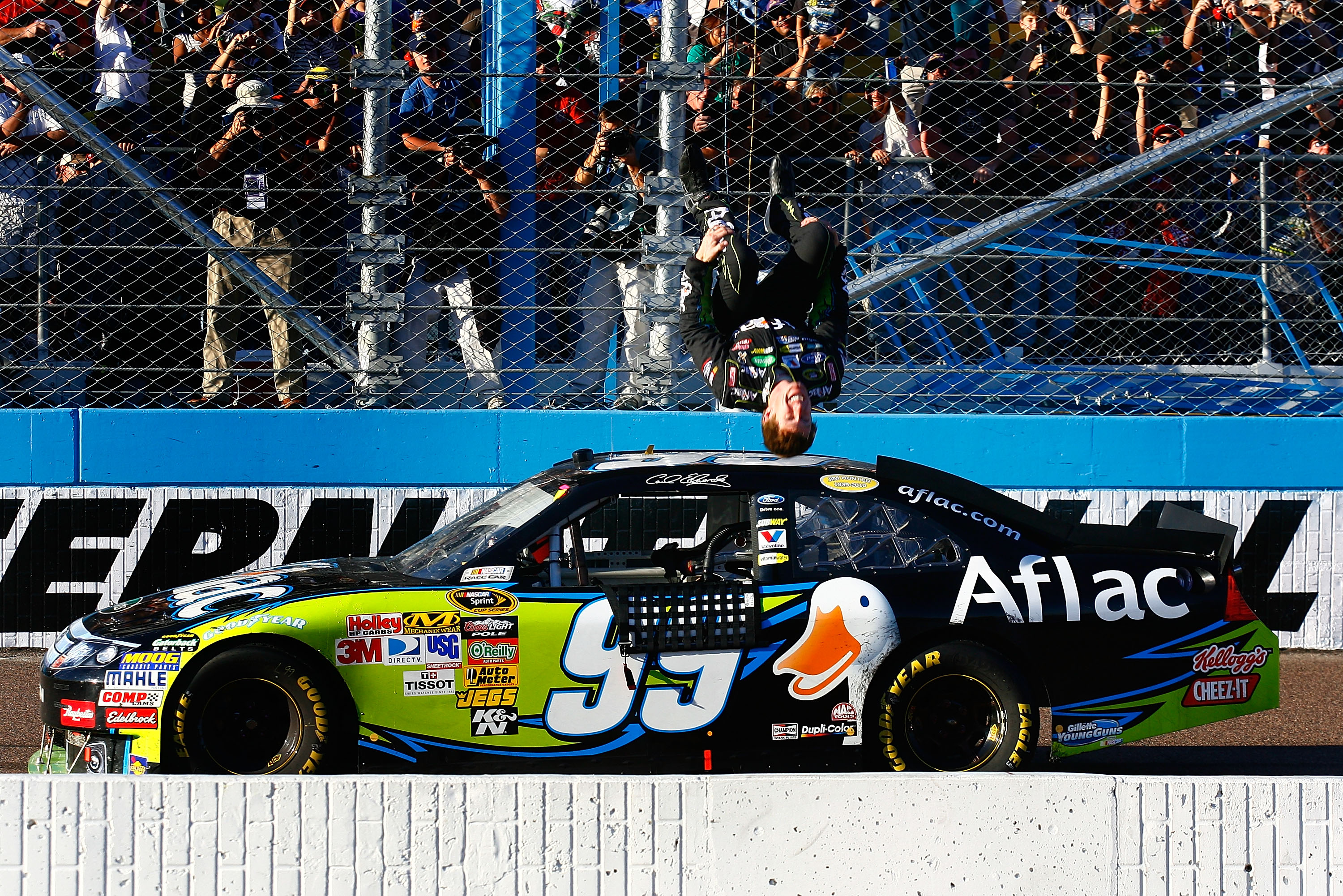 AVONDALE, AZ - NOVEMBER 14:  Carl Edwards, driver of the #99 Aflac Ford, performs a backflip after winning the NASCAR Sprint Cup Series Kobalt Tools 500 at Phoenix International Raceway on November 14, 2010 in Avondale, Arizona.  (Photo by Jason Smith/Get