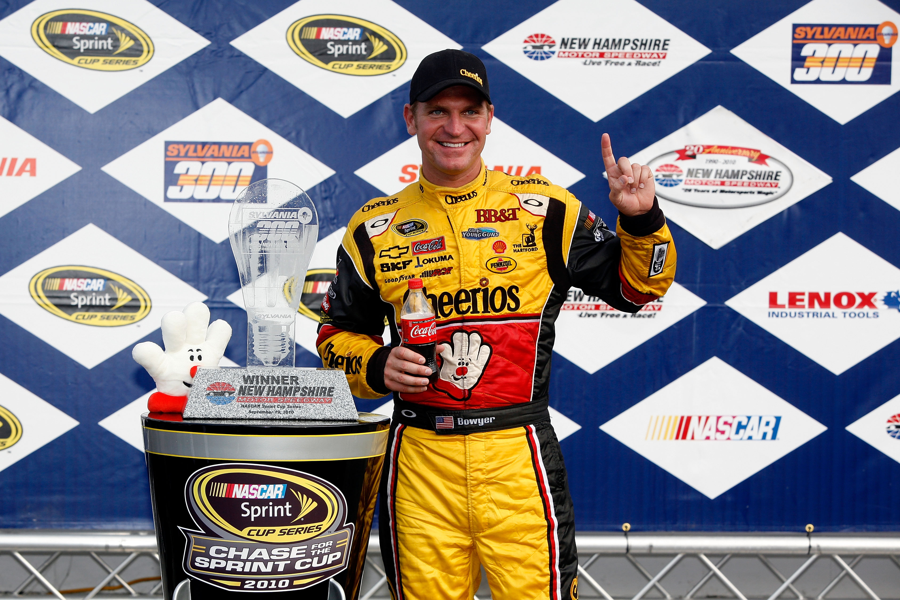 LOUDON, NH - SEPTEMBER 19:  Clint Bowyer, driver of the #33 Cheerios / Hamburger Helper Chevrolet celebrates with the trophy in victory lane after winning the NASCAR Sprint Cup Series Sylvania 300 at New Hampshire Motor Speedway on September 19, 2010 in L