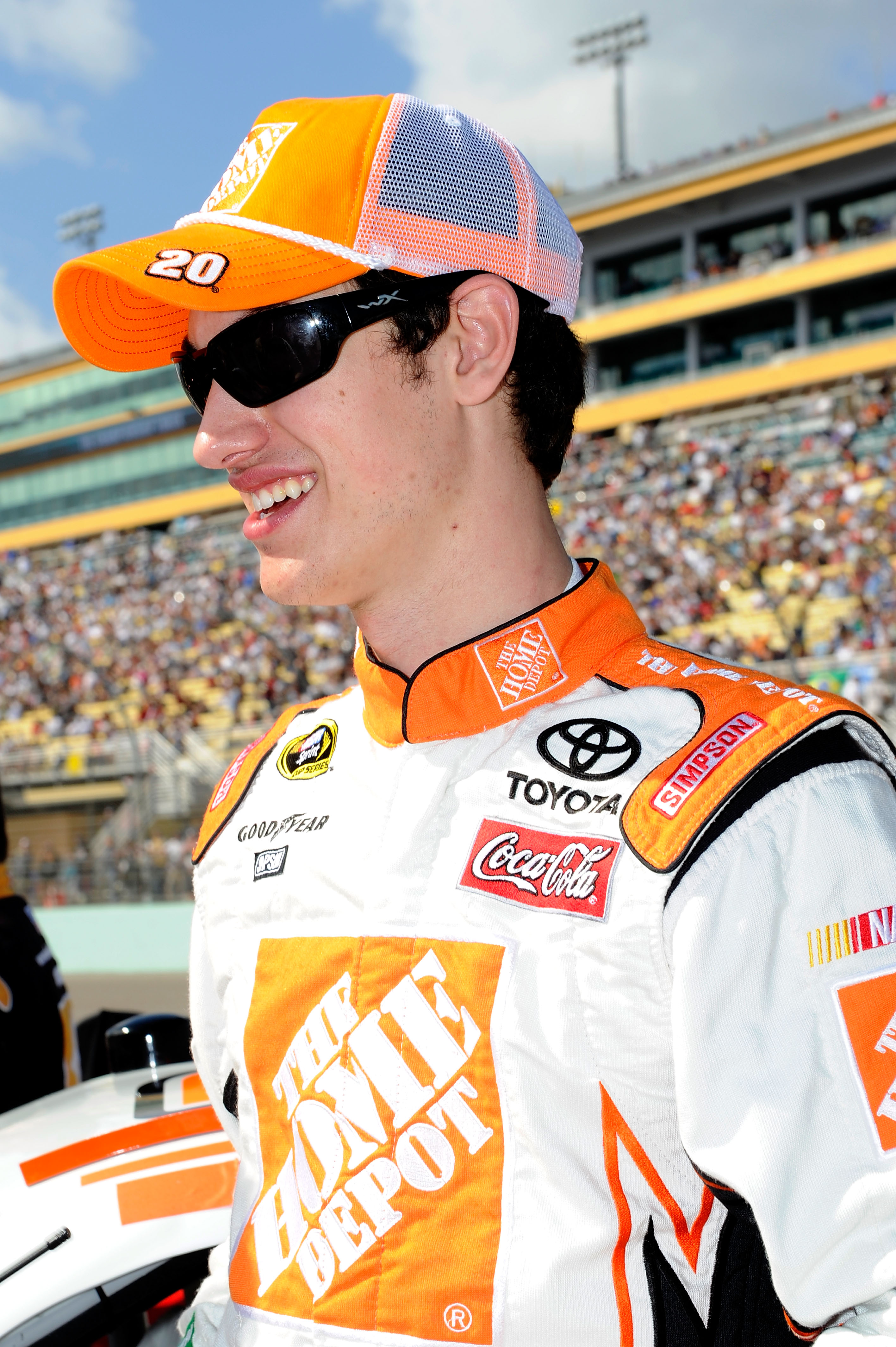 HOMESTEAD, FL - NOVEMBER 21:  Joey Logano, driver of the #20 Home Depot Toyota, stands on pit road prior to the NASCAR Sprint Cup Series Ford 400 at Homestead-Miami Speedway on November 21, 2010 in Homestead, Florida.  (Photo by John Harrelson/Getty Image