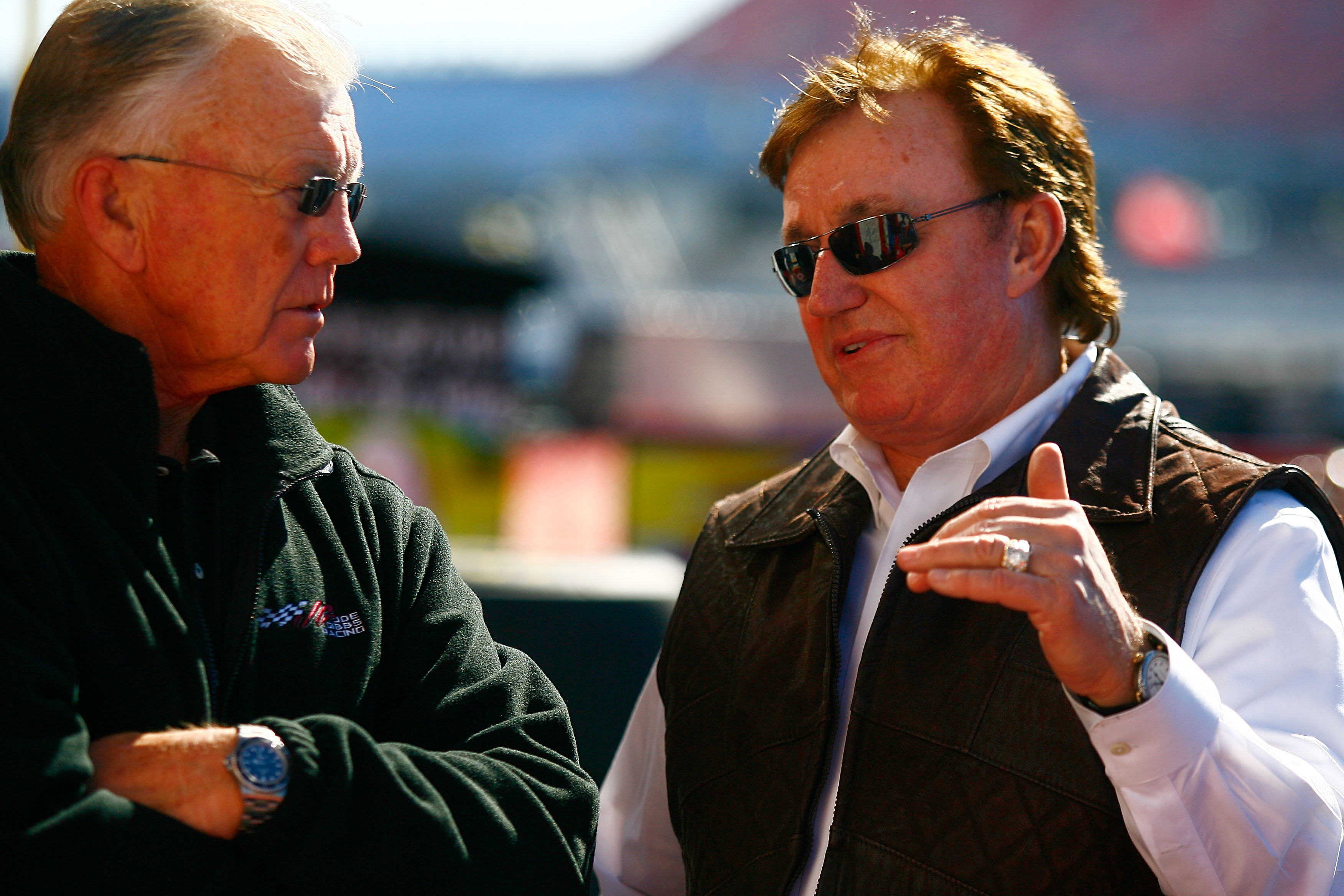 TALLADEGA, AL - OCTOBER 29:  Team owners Joe Gibbs (L) and Richard Childress talk in the garage area during practice for the NASCAR Sprint Cup Series AMP Energy Juice 500 at Talladega Superspeedway on October 29, 2010 in Talladega, Alabama.  (Photo by Jas