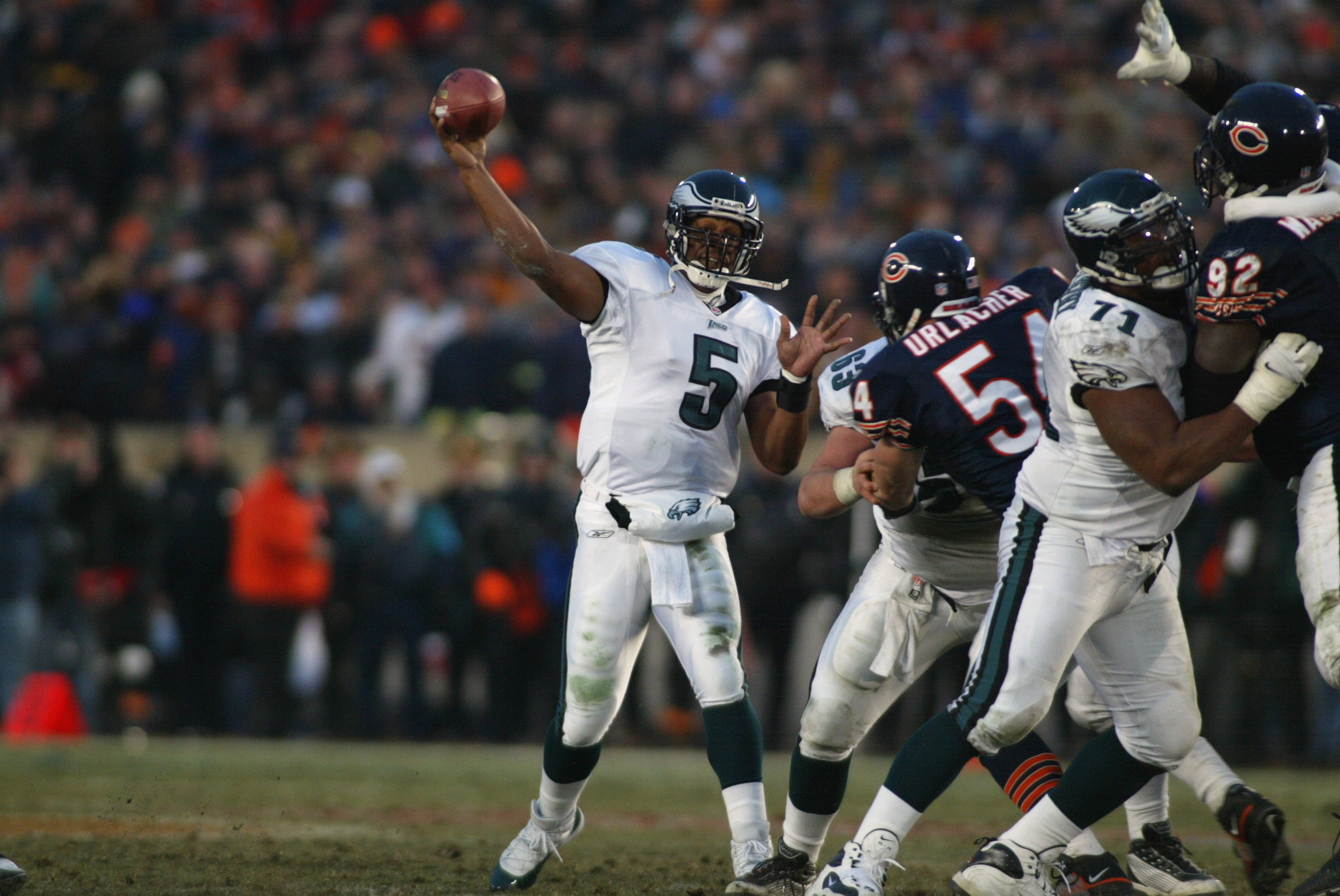19 Jan 2002:  Quarterback Donovan McNabb #5  of the Philadelphia Eagles delivers a pass against the defense of Brian Urlacher #54 of the Chicago Bears during the NFC Divisional Playoff at Soldier Field in Chicago, Illinois. Eagles win 33-19 over the Bears